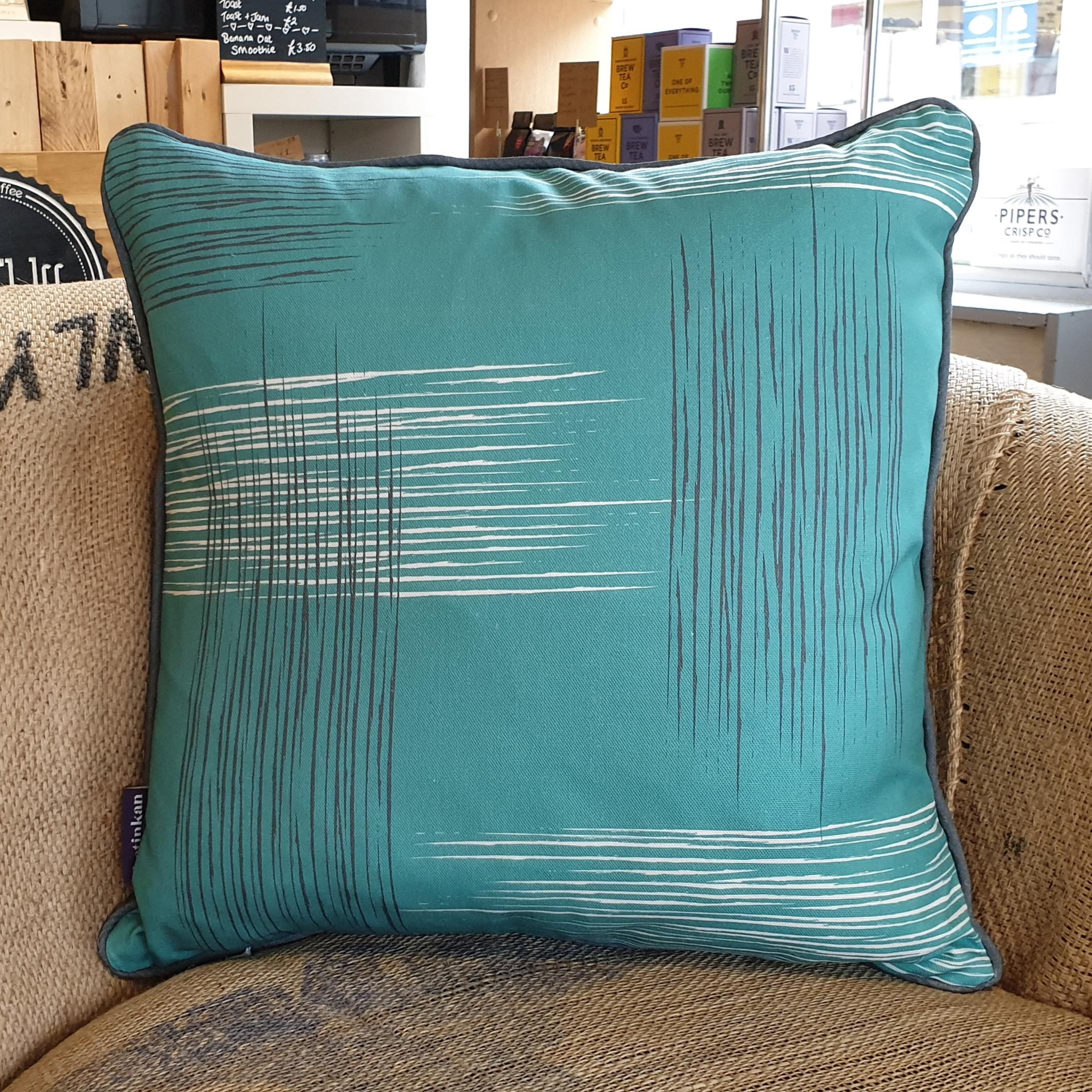 Double-sided aqua teal 45cm square retro themed cushion with artistic grey and white shards and grey handcrafted piping designed by thetinkan. Available with an optional luxury cushion inner pad. VIEW PRODUCT >>