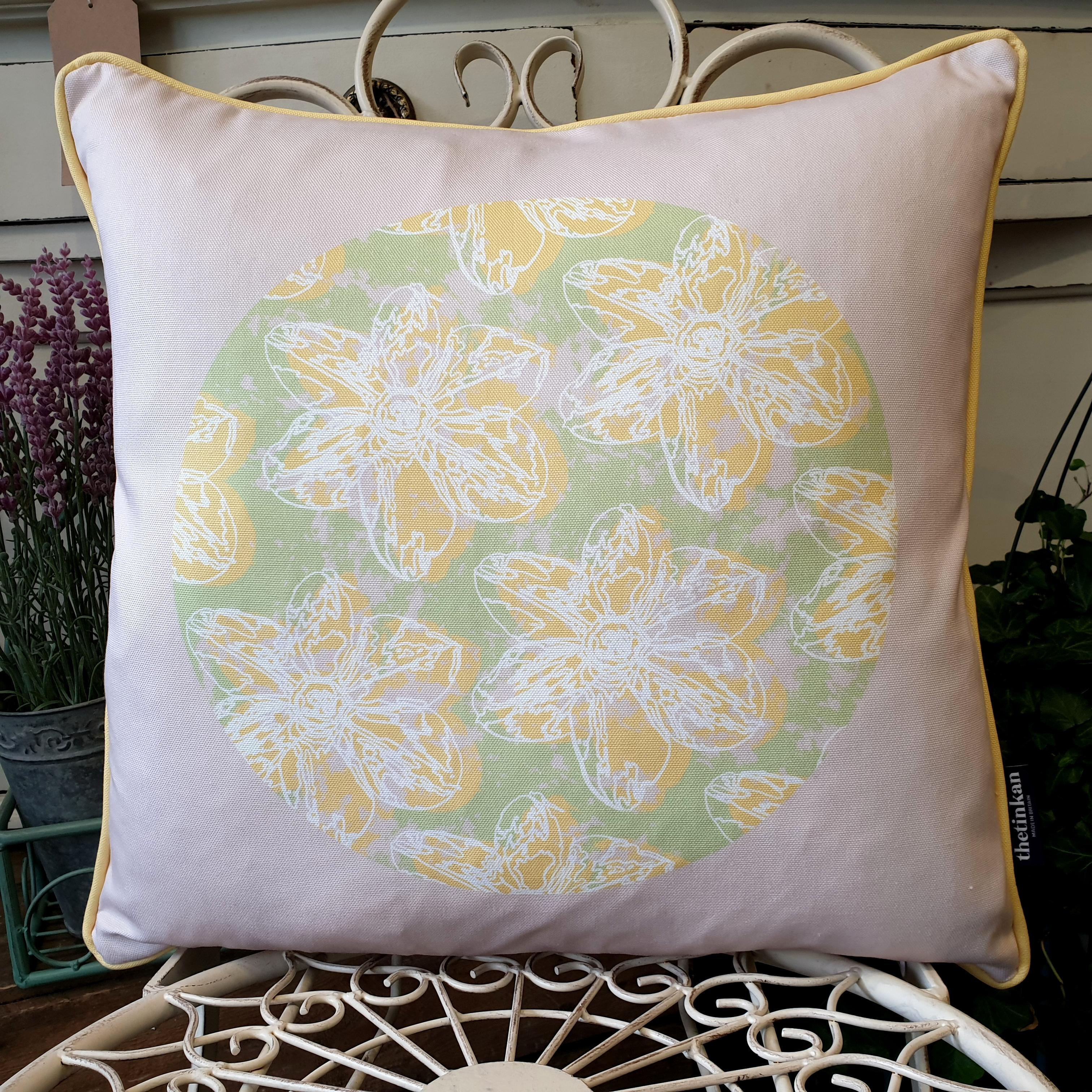 Double-sided 45cm square Flower Splash cushion designed by thetinkan. Yellow narcissus flower with white traced outline and yellow piping set in a mint green coloured circle with pale pink paint splashes and pale pink surround. Available with an optional luxury cushion inner pad. VIEW PRODUCT >>