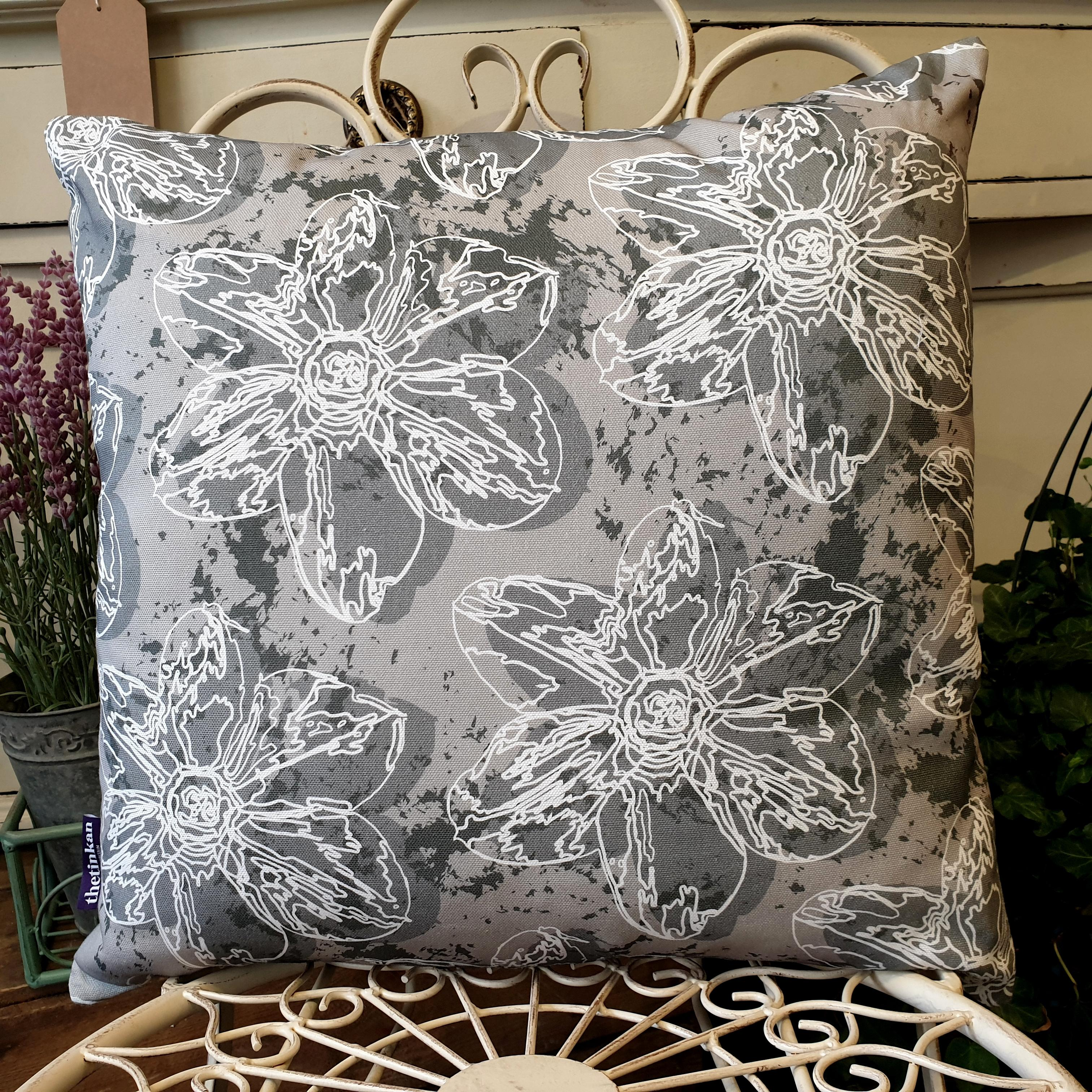 Double-sided 45cm square Flower Splash cushion designed by thetinkan. Dark grey narcissus flower with white traced outline set within a grey background with charcoal grey paint splashes. Available with an optional luxury cushion inner pad. VIEW PRODUCT >>