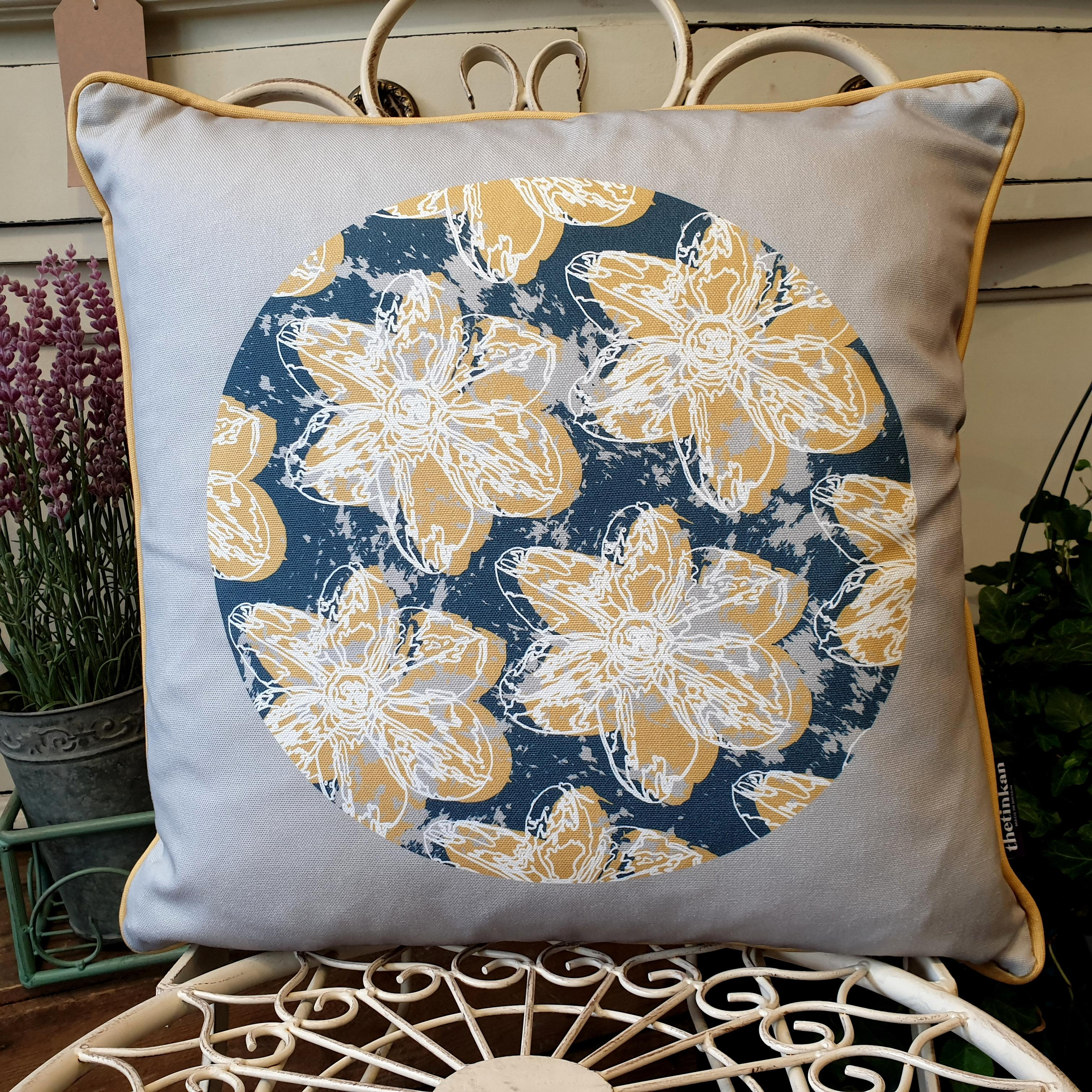 Double-sided 45cm square Flower Splash cushion designed by thetinkan. Mustard yellow narcissus flower with white traced outline and mustard yellow piping set in an oxford blue coloured circle with pale grey paint splashes and pale grey surround. Available with an optional luxury cushion inner pad. VIEW PRODUCT >>