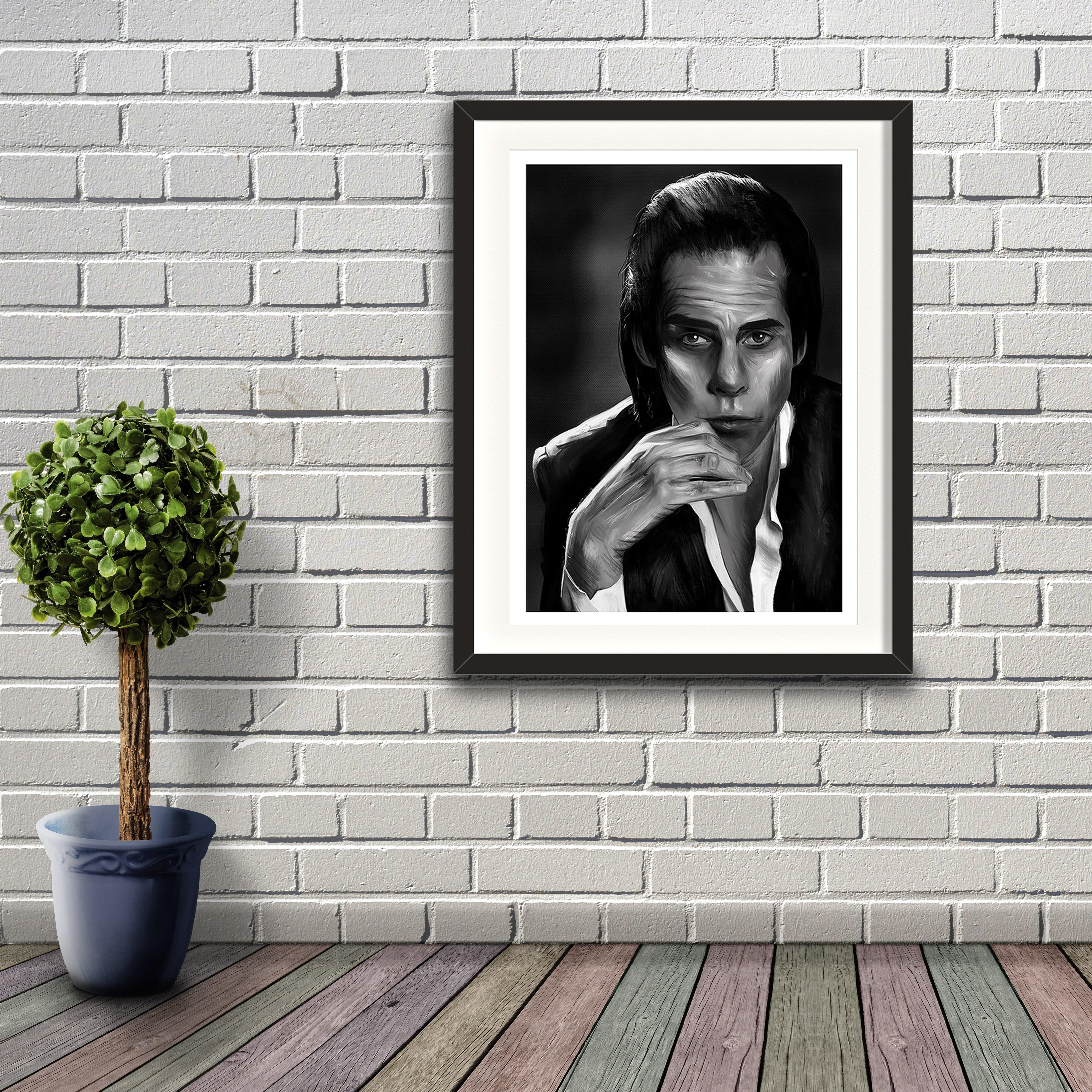 A digital painting called Nick Cave Study 1 by Lily Bourne showing black and white posed image of songwriter and performer Nick Cave. Artwork shown in a black frame hanging on a brick wall.