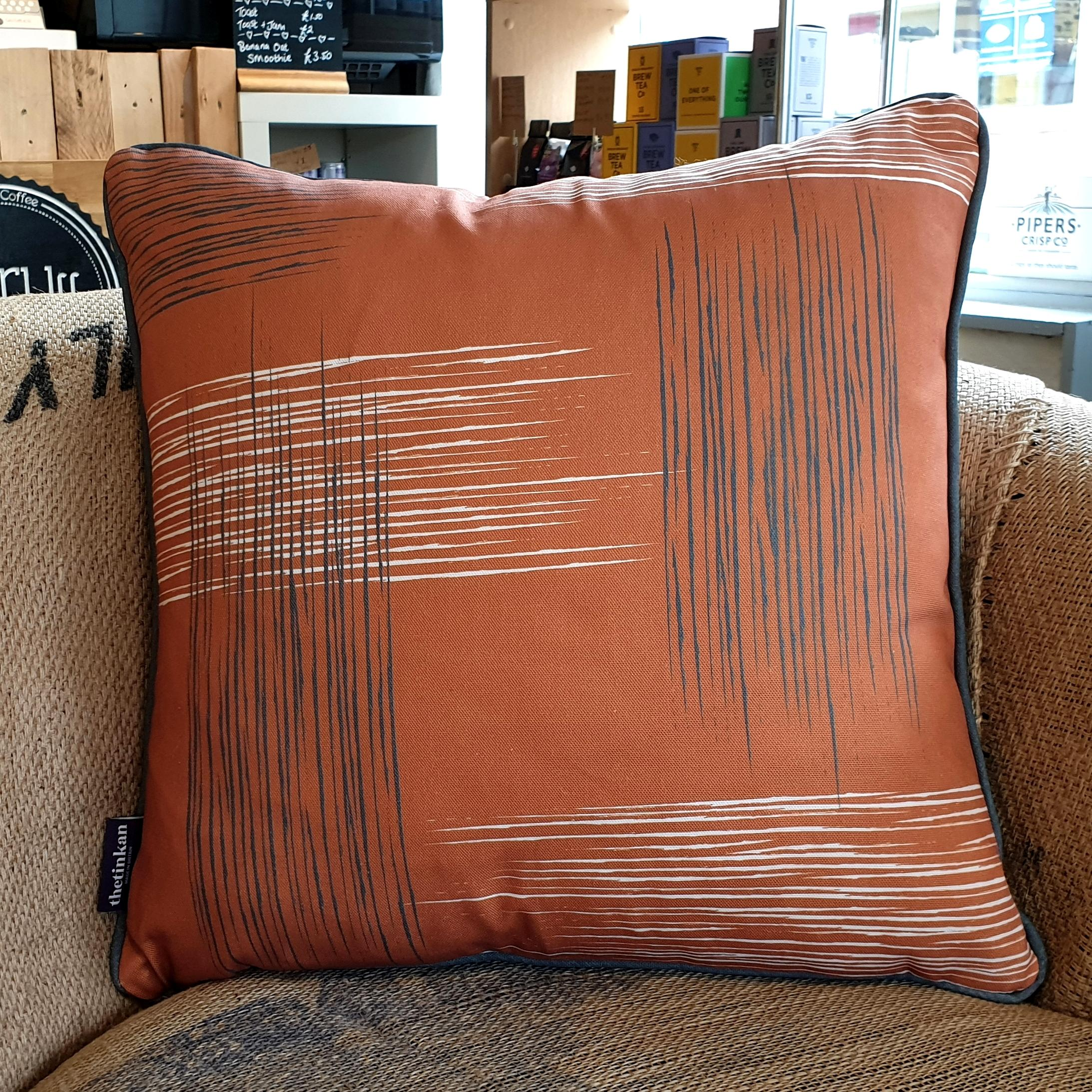 Double-sided warm rust orange 45cm square retro themed cushion with artistic grey and white shards and grey handcrafted piping designed by thetinkan. Available with an optional luxury cushion inner pad. VIEW PRODUCT >>