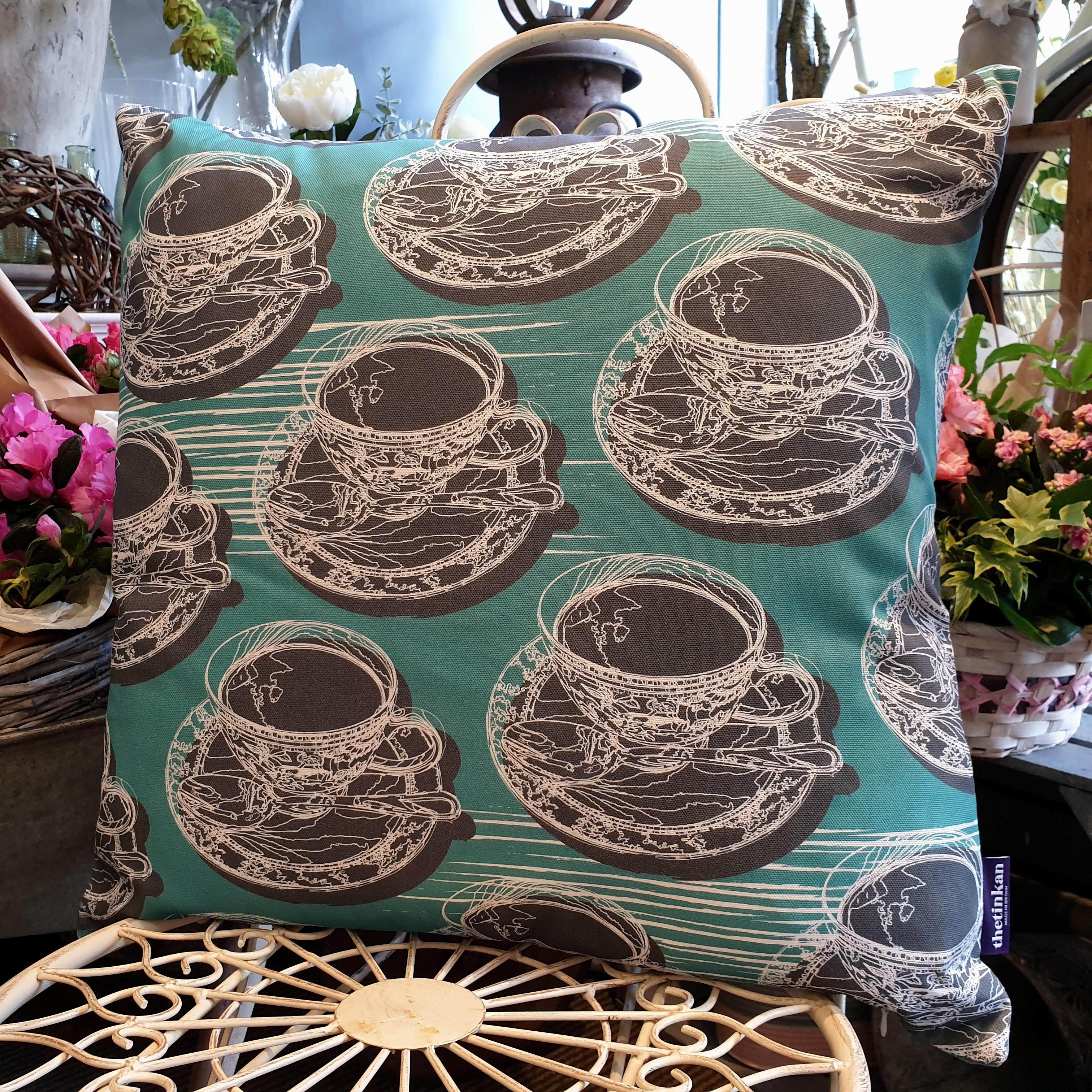 Double-sided aqua teal 51cm square retro Afternoon Tea cushion with artistic white shards designed by thetinkan. White traced outline of multiple British teacups and saucers each colour filled in charcoal grey. Available with an optional luxury cushion inner pad. VIEW PRODUCT >>
