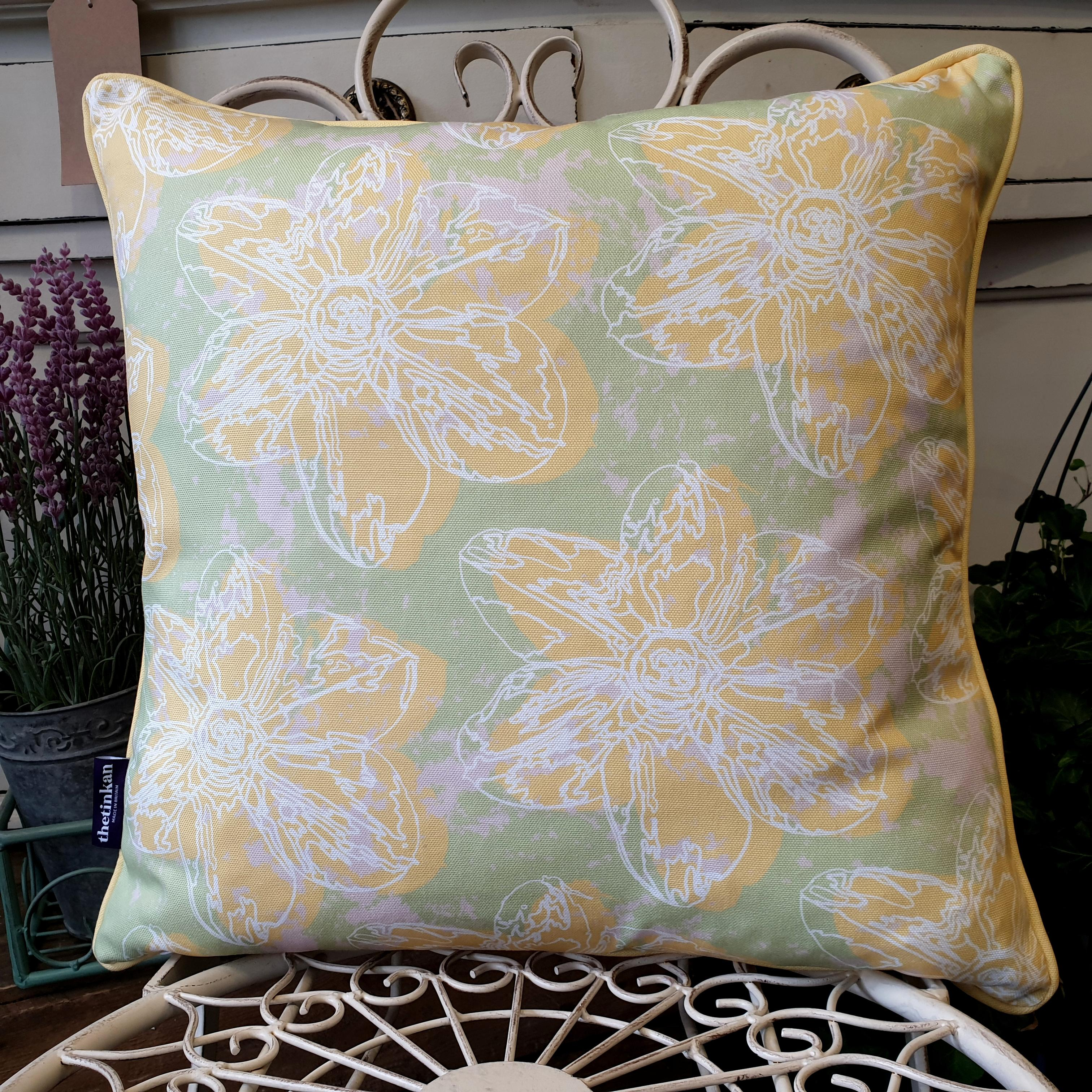 Double-sided 45cm square Flower Splash cushion designed by thetinkan. Yellow narcissus flower and yellow piping with white traced outline set within a mint green background with pale pink paint splashes. Available with an optional luxury cushion inner pad. VIEW PRODUCT >>