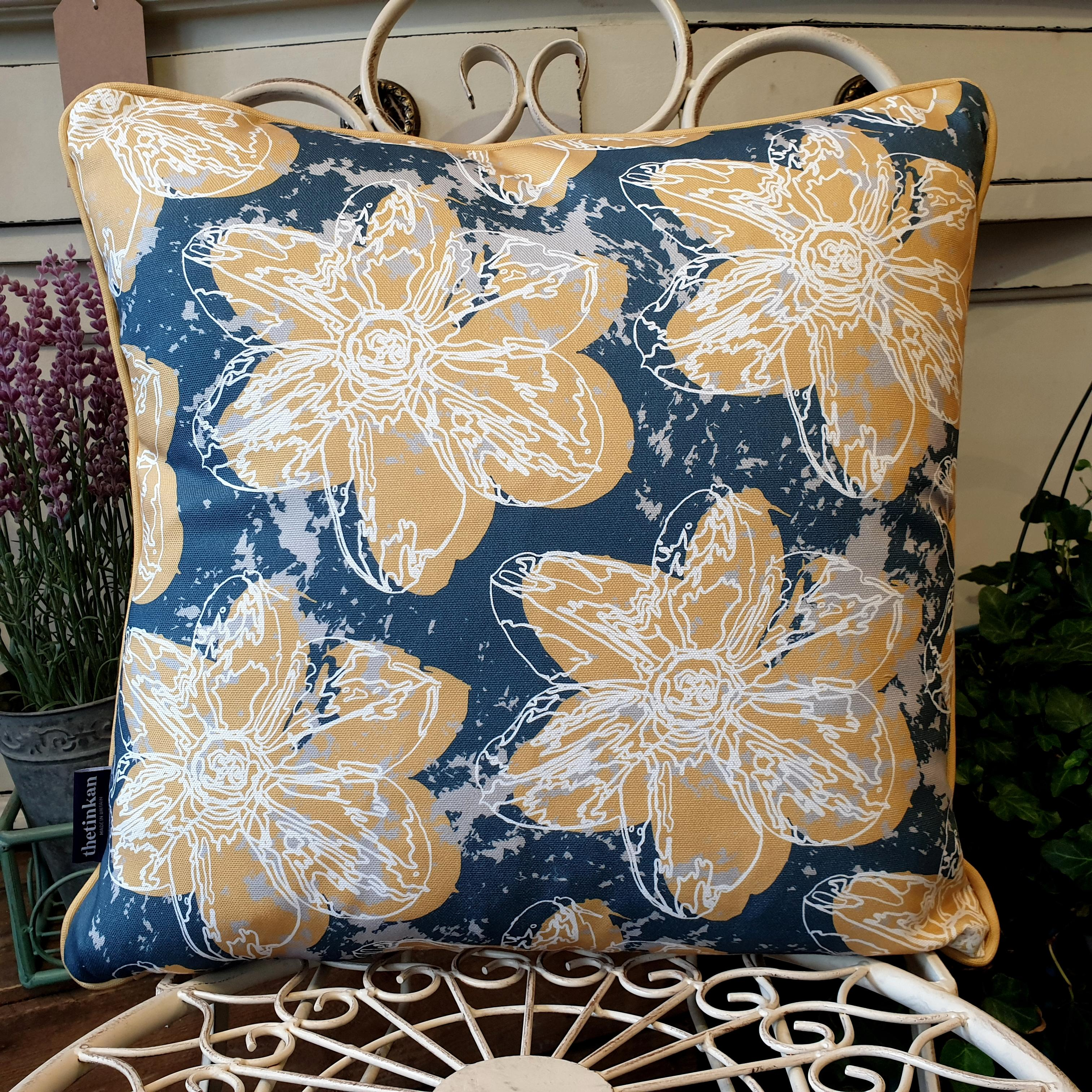 Double-sided 45cm square Flower Splash cushion designed by thetinkan. Mustard yellow narcissus flower and mustard yellow piping with white traced outline set within an oxford blue background with pale grey paint splashes. Available with an optional luxury cushion inner pad. VIEW PRODUCT >>