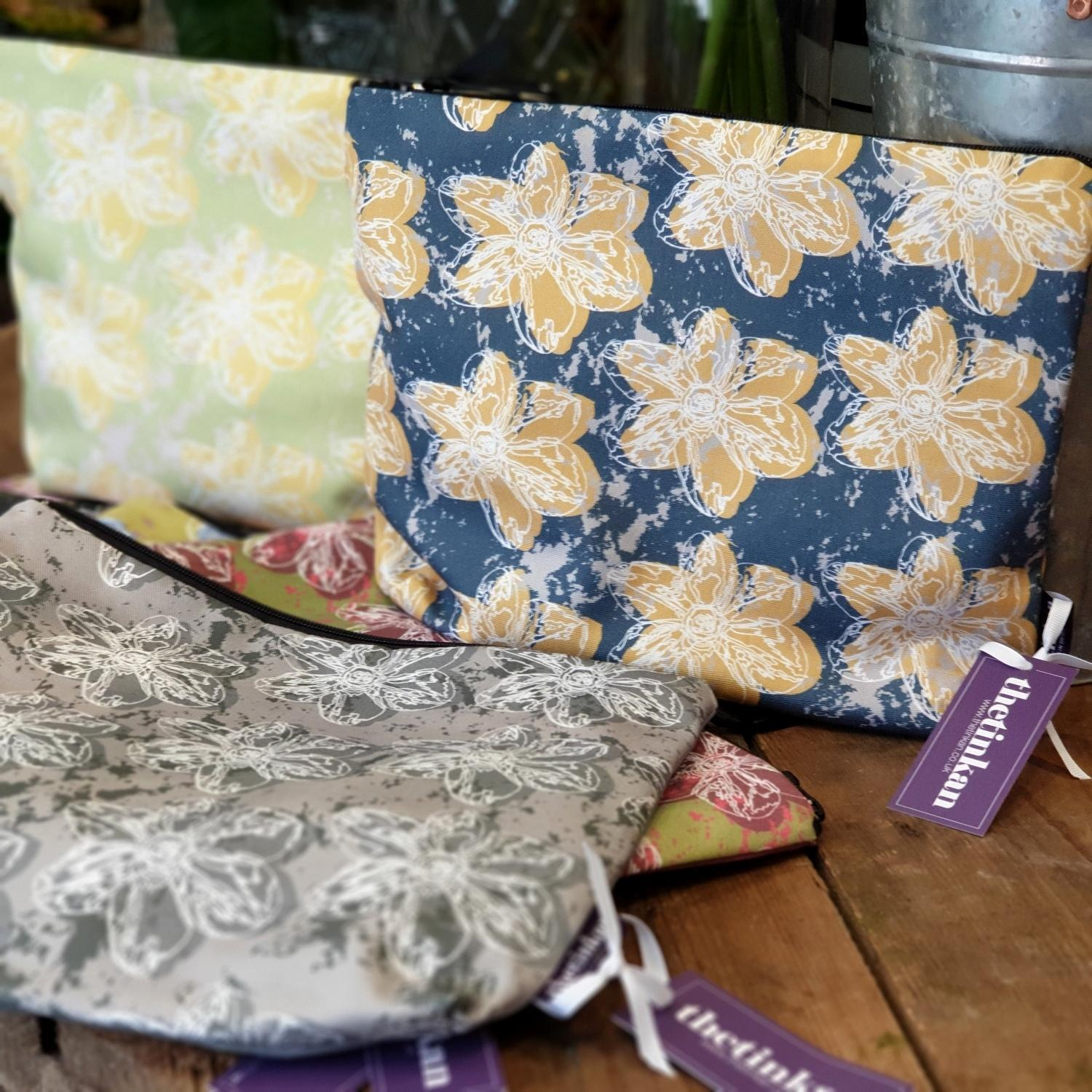 A generously sized travel beauty washbag featuring the white traced outline of a narcissus flower. Available in six colours and made from panama cotton with black waterproof lining and matching black sturdy zip. Suitable for all your travel or home needs. Designed by thetinkan. VIEW PRODUCT >>