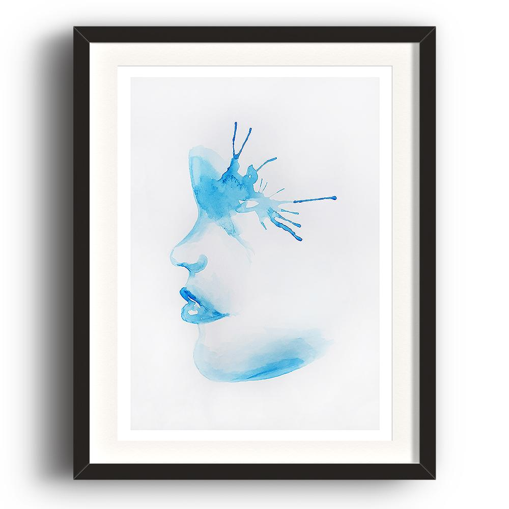 A watercolour print by Clarrie-Anne on eco fine art paper titled A Splash Of The Blues show a blue watercoloue side profile of a female face with a paint splash around the eye. The image is set in a black coloured picture frame.