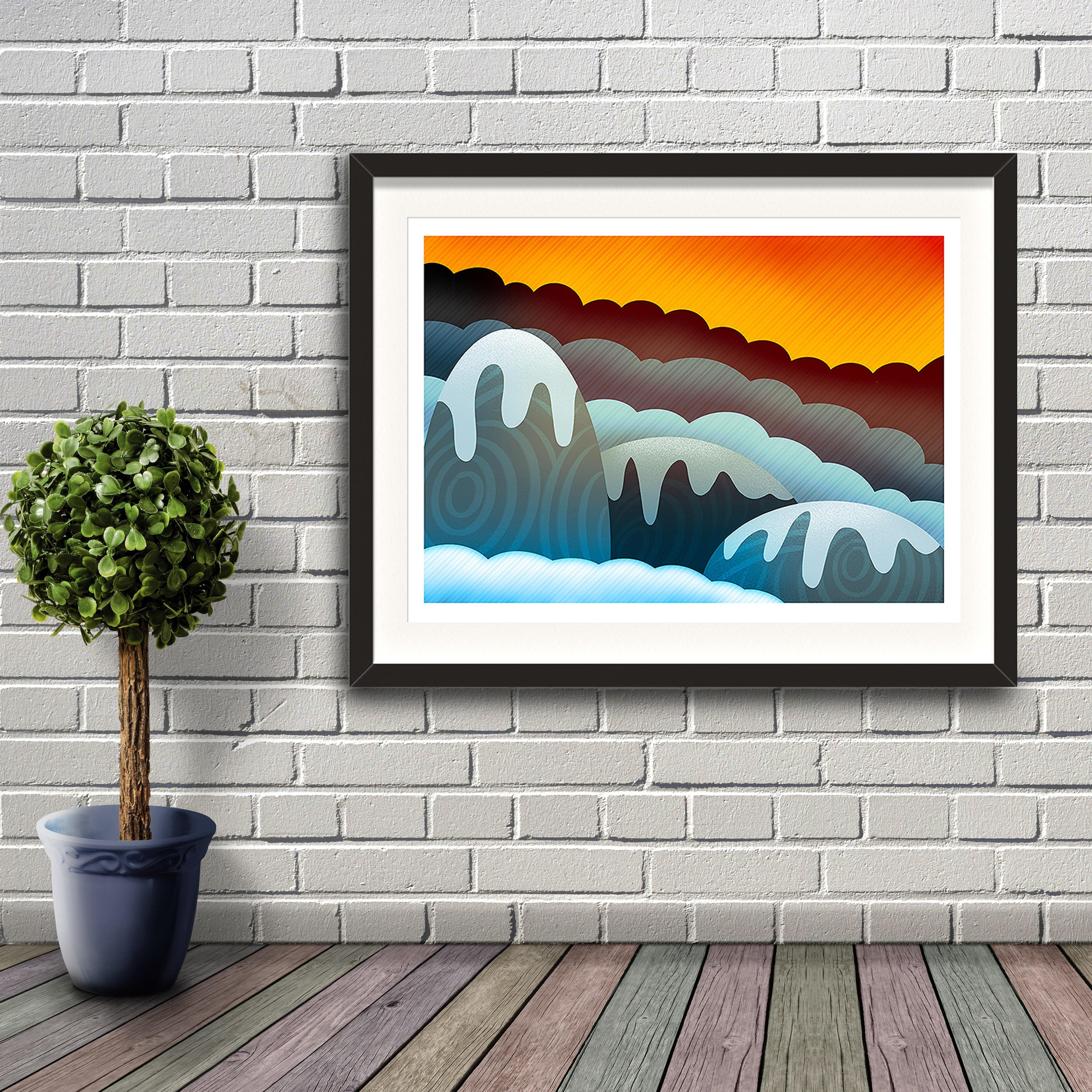 A digital painting called Mountain Glow by Lily Bourne showing an orange sky with snow covered rounded animated mountains. Artwork shown in a black frame hanging on a brick wall.