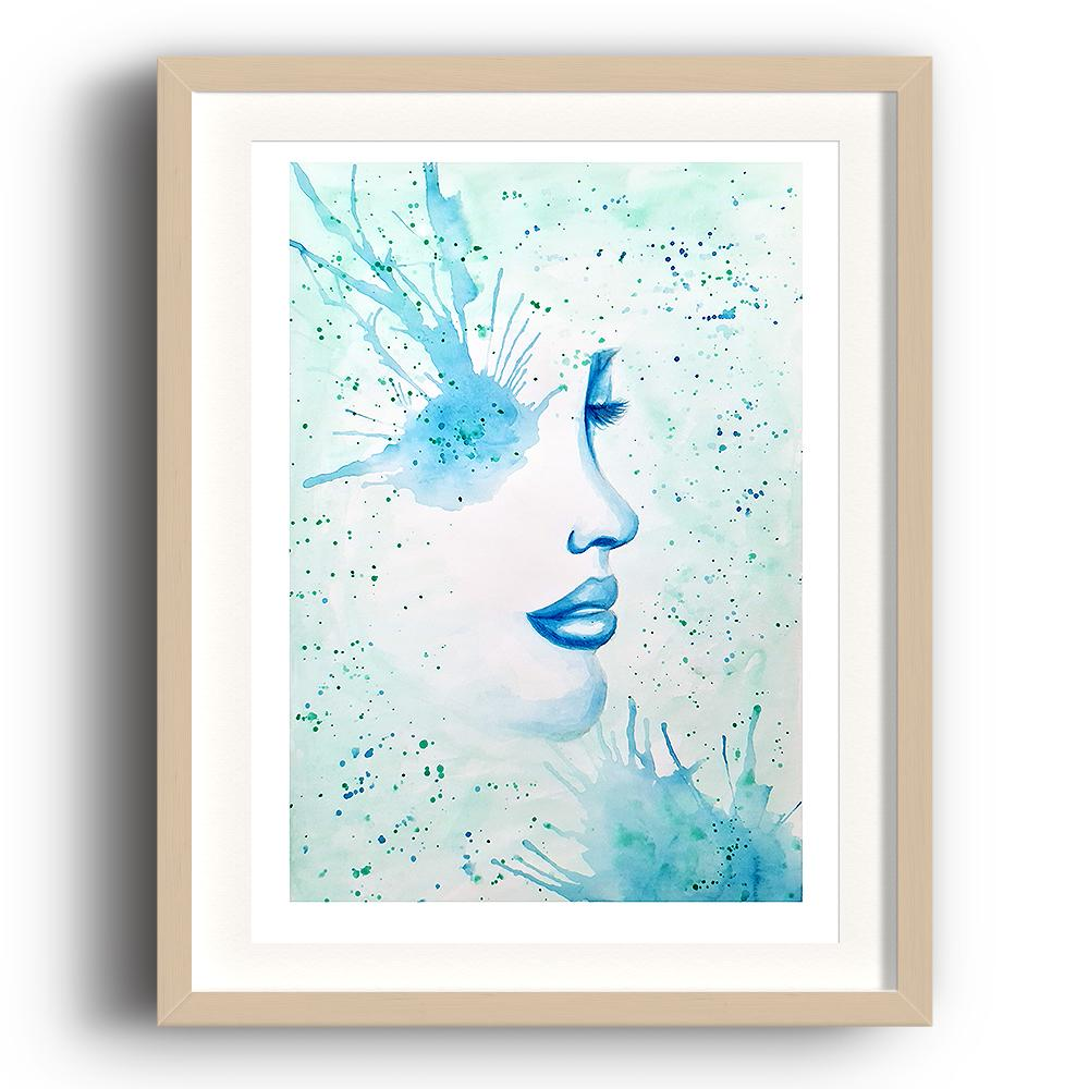 A watercolour print by Clarrie-Anne on eco fine art paper titled Surfacing showing a black watercolour outlined female face with a blue paint splattered eye and paint splatters across the picture. The image is set in a beech coloured picture frame.