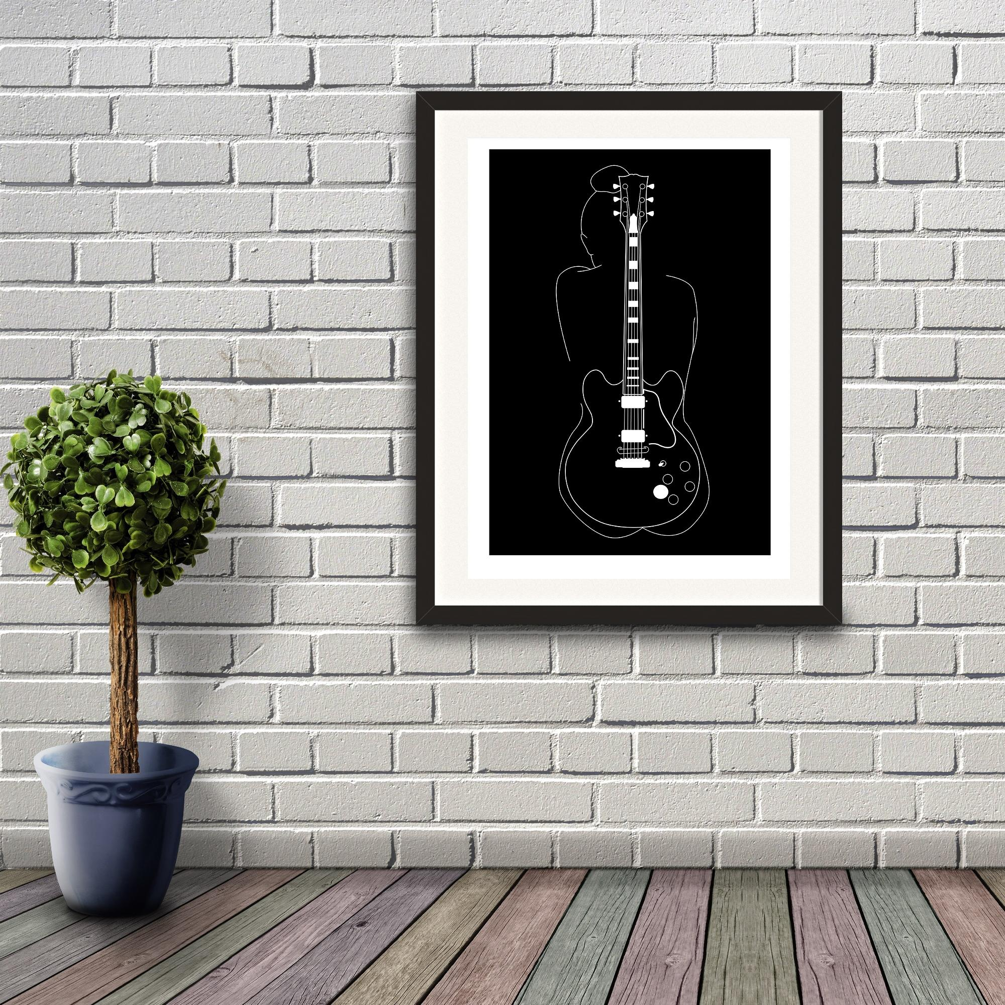 A digital illustration by Clarrie-Anne giclée printed on eco fine art paper titled Lucille. Featuring a white line outline of a female and the Gibson guitar of BB King with a black background. Mock up print image shown on an interior brick wall.