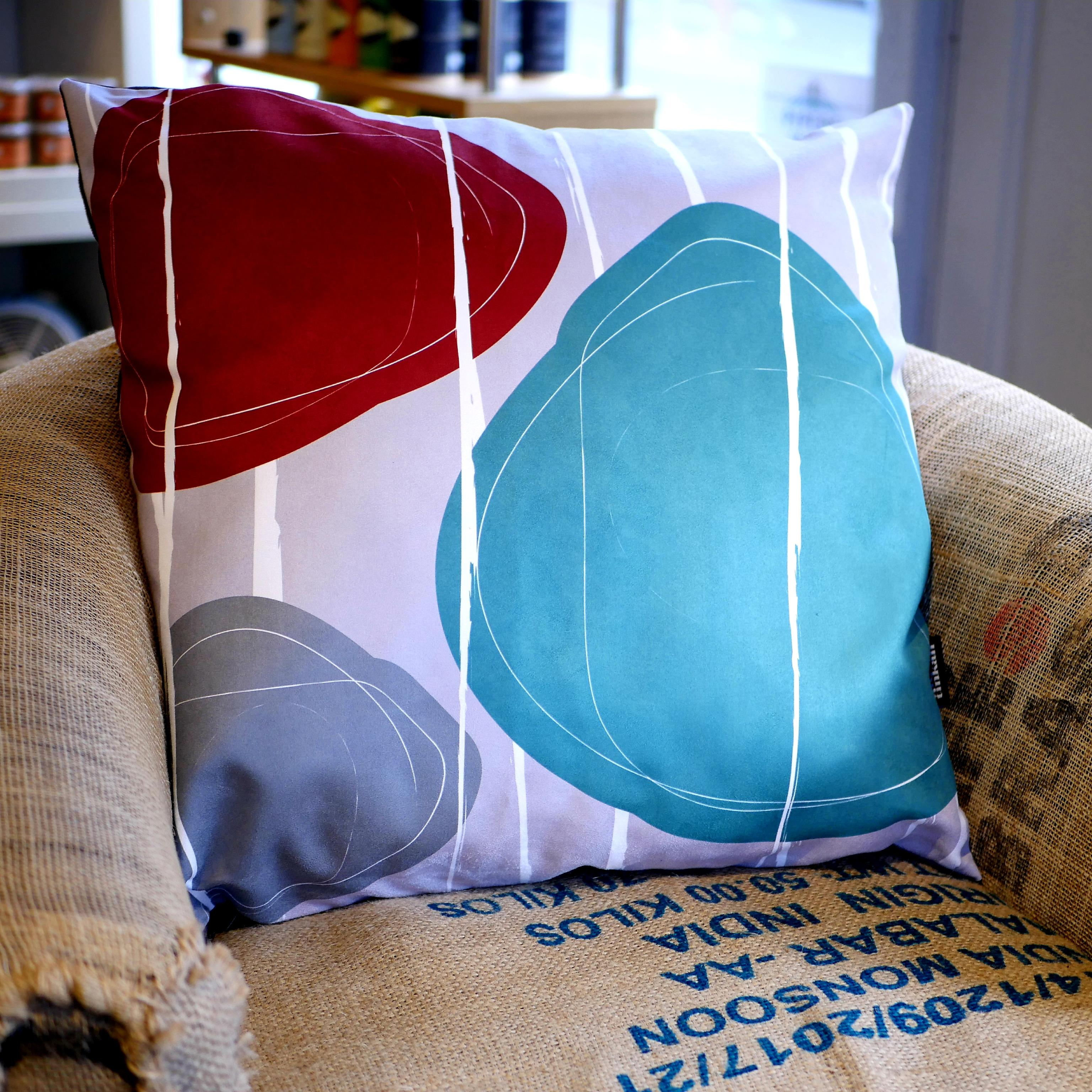 Aqua teal, red & grey faux suede soft feel Abstract Pebbles Cushion, 57cm square, with luxury inner pad designed by thetinkan. VIEW PRODUCT >>