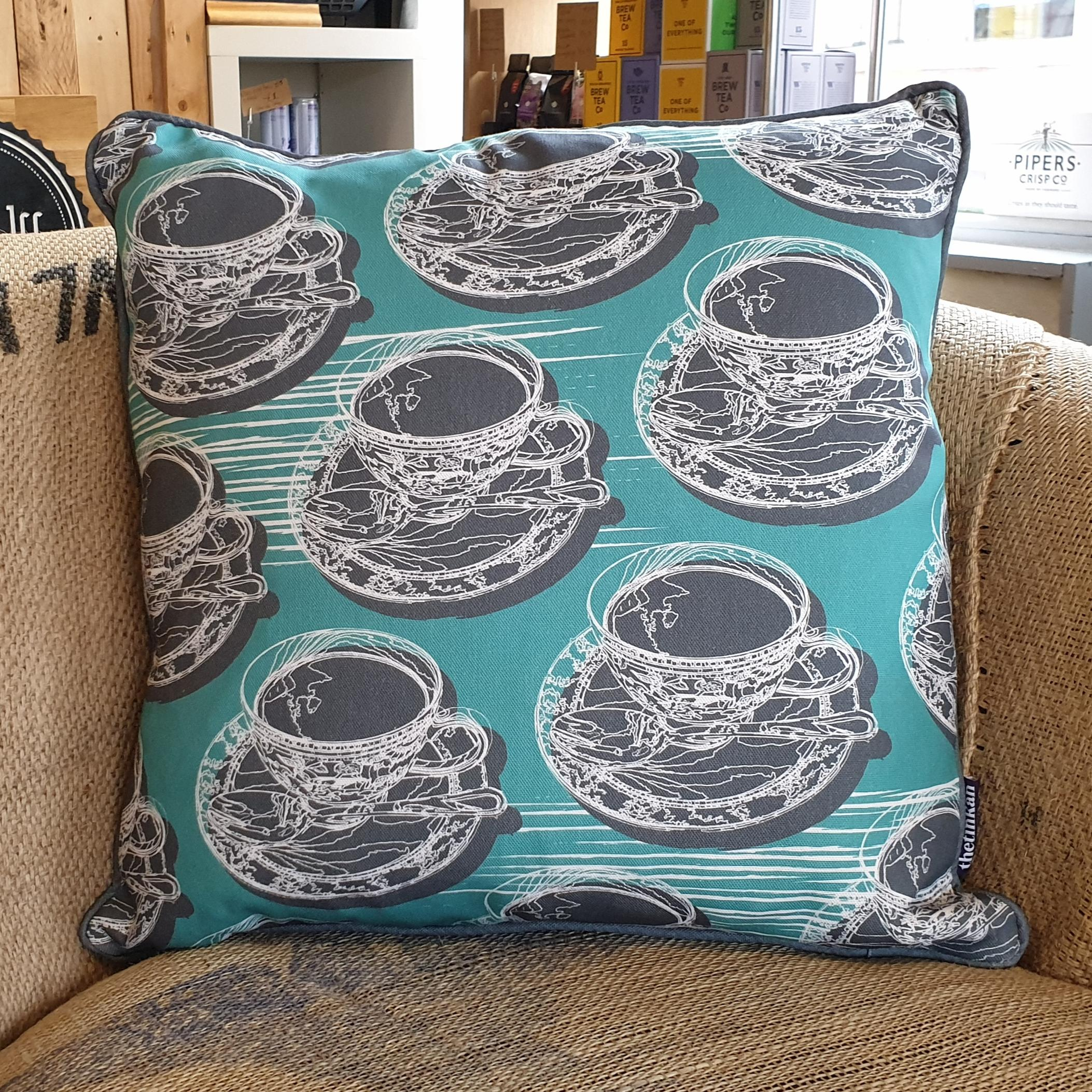 Double-sided aqua teal 45cm square retro Afternoon Tea cushion with artistic white shards and grey handcrafted piping designed by thetinkan. White traced outline of multiple British teacups and saucers each colour filled in charcoal grey. Available with an optional luxury cushion inner pad. VIEW PRODUCT >>