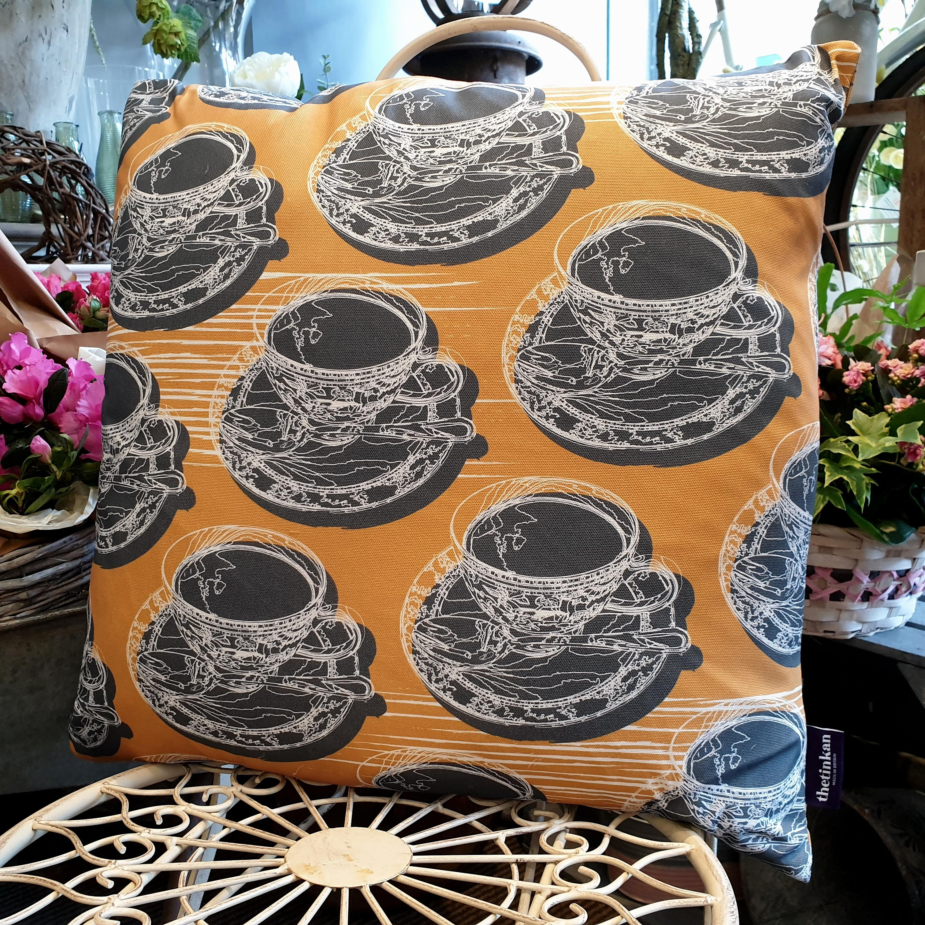 Double-sided mustard yellow 51cm square retro Afternoon Tea cushion with artistic white shards designed by thetinkan. White traced outline of multiple British teacups and saucers each colour filled in charcoal grey. Available with an optional luxury cushion inner pad. VIEW PRODUCT >>