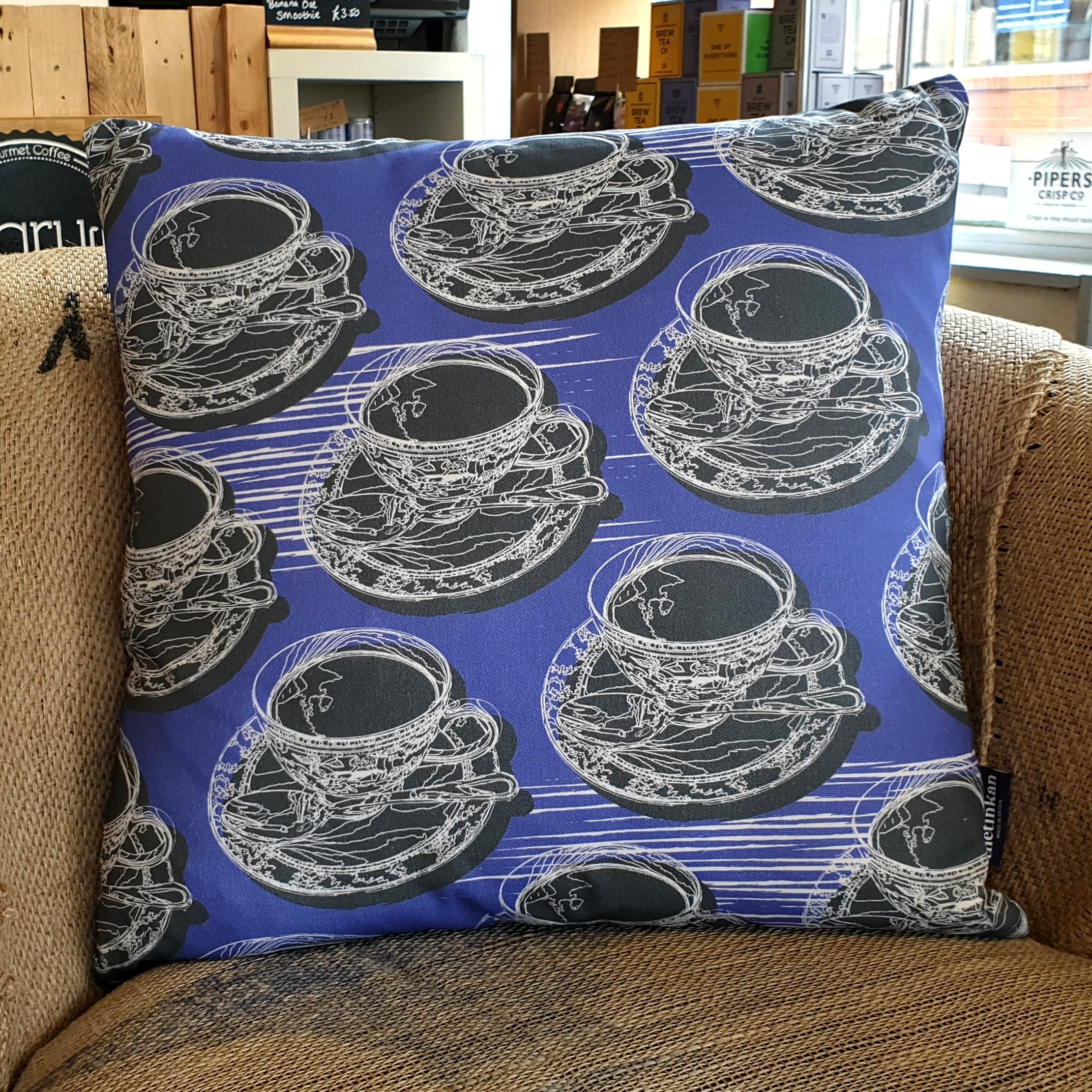Double-sided violet purple 45cm square retro Afternoon Tea cushion with artistic white shards designed by thetinkan. White traced outline of multiple British teacups and saucers each colour filled in charcoal grey. Available with an optional luxury cushion inner pad. VIEW PRODUCT >>