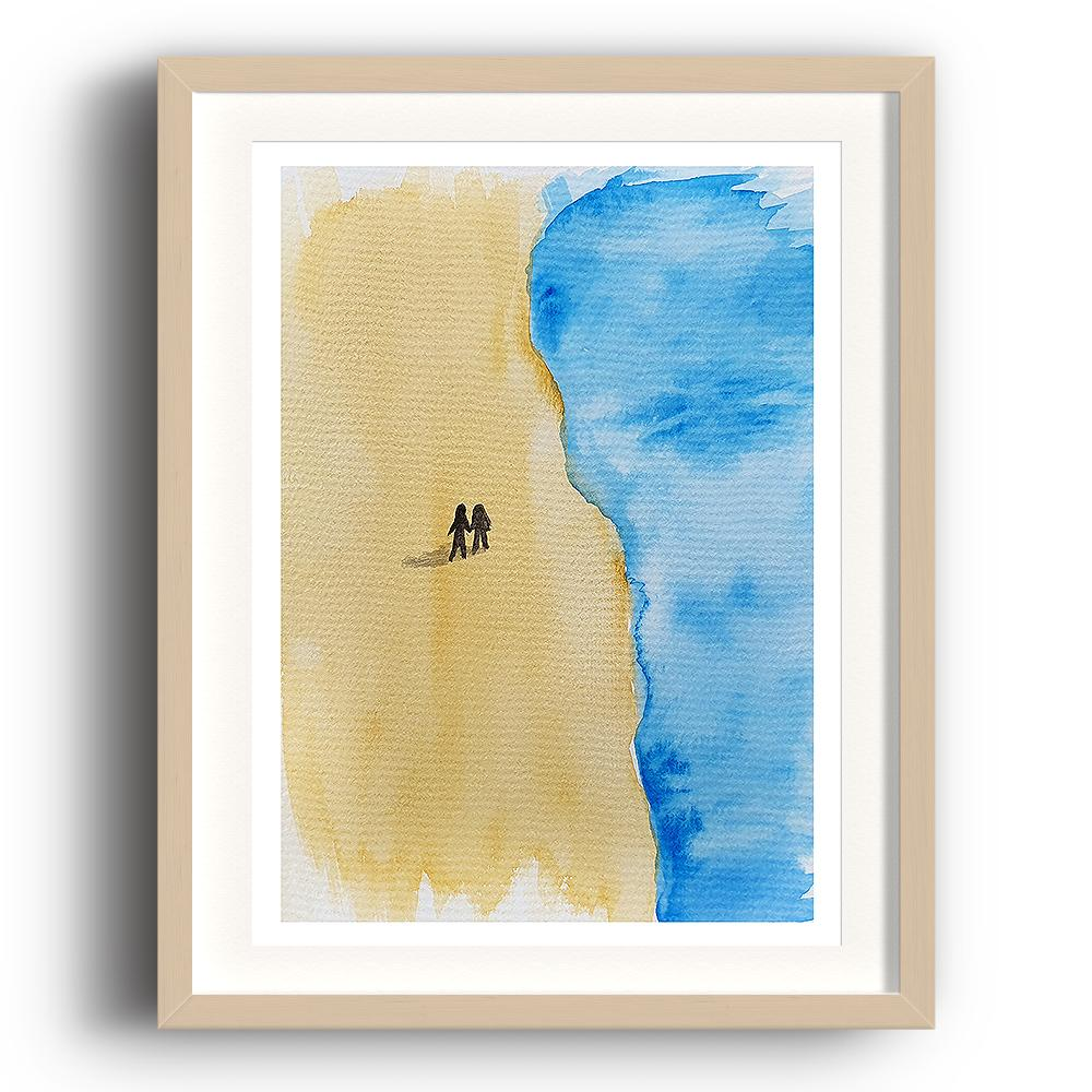 A watercolour print by Clarrie-Anne on eco fine art paper titled Take A Walk In Your Mind showing a deserted sandy beach from above with the sea approaching from the right and two small figures silhouetted alone on the beach holding hands. The image is set in a beech coloured picture frame.