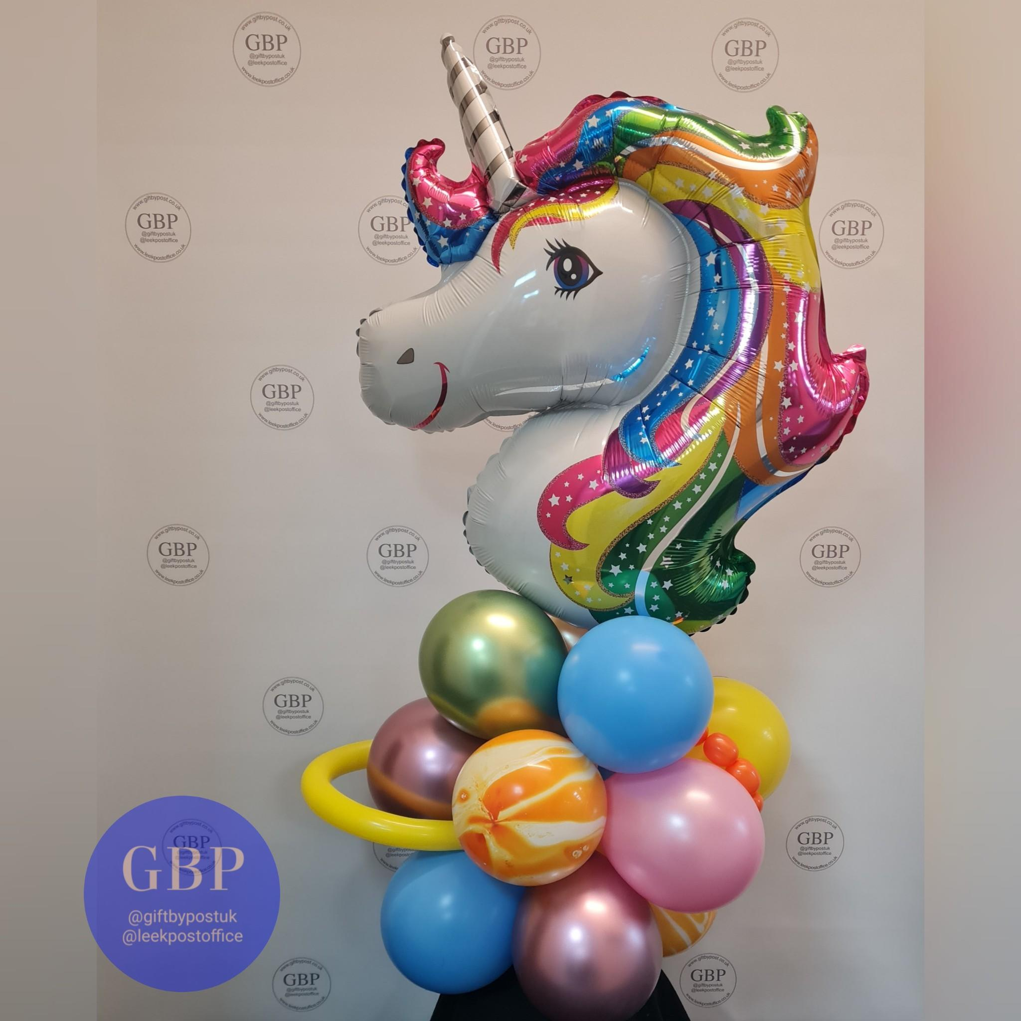 Large multi coloured rainbow unicorn balloon on a base