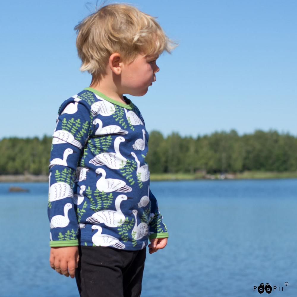 image of long sleeve top in swan blueberry print being worn by child