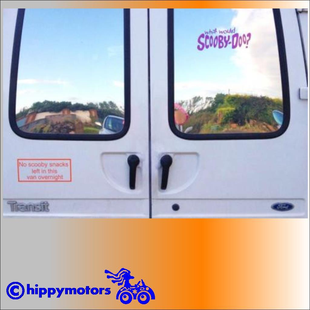 scooby overnight sticker on back of camper van