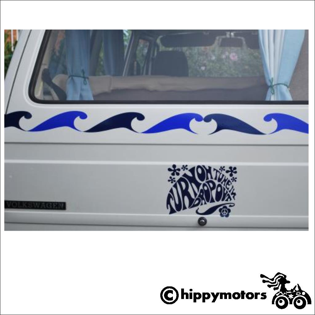 van with a vinyl sticker with the well known hippy saying turn on tune in with waves