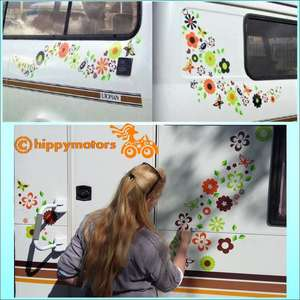 Flower and spider vinyl sticker pack of decals on a white van