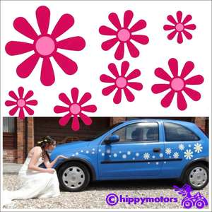 Daisy stickers on wedding car with bride