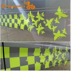 Vinyl sticker Racing Checks changing to Butterflies on a camper van