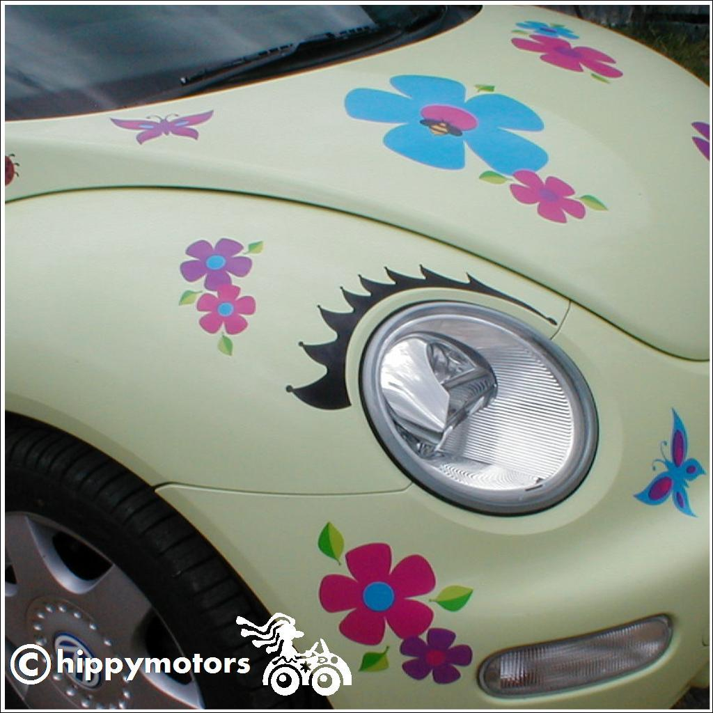 eye lash vinyl decals on VW beetle car with flower stickers