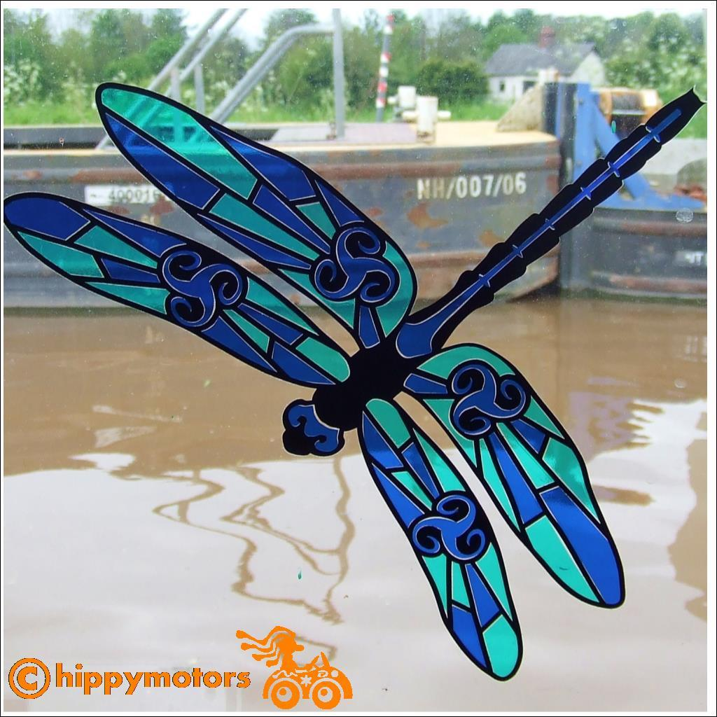 dragonfly window sticker on canal boat glass