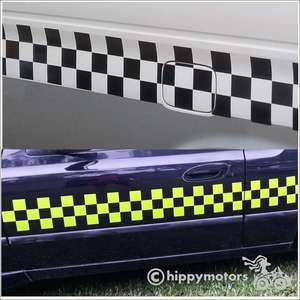 Racing check vinyl decals on camper vans and car