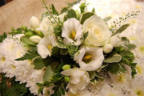 Green and White Cushion Funeral Flowers