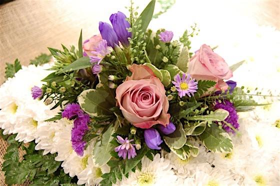 Lilac and Purple Cushion Funeral Flowers