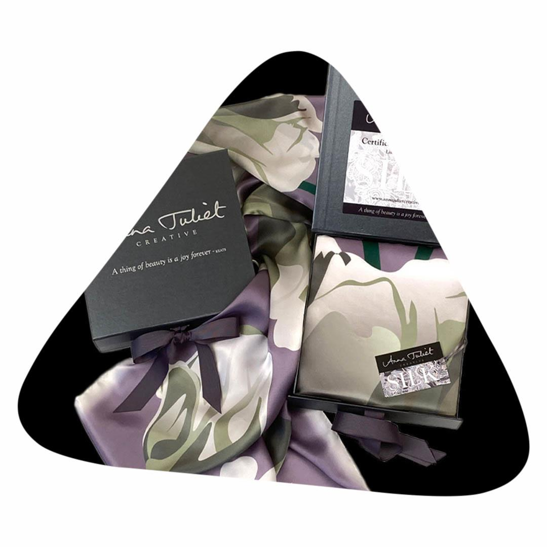Pure silk scarf in a branded pewter-coloured gift box.