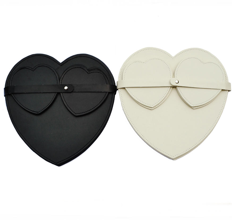 Set Of Four Heart Placemats And Coasters In Black Or Cream