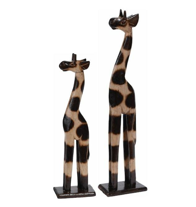 Rustic wooden carved giraffe ornaments.