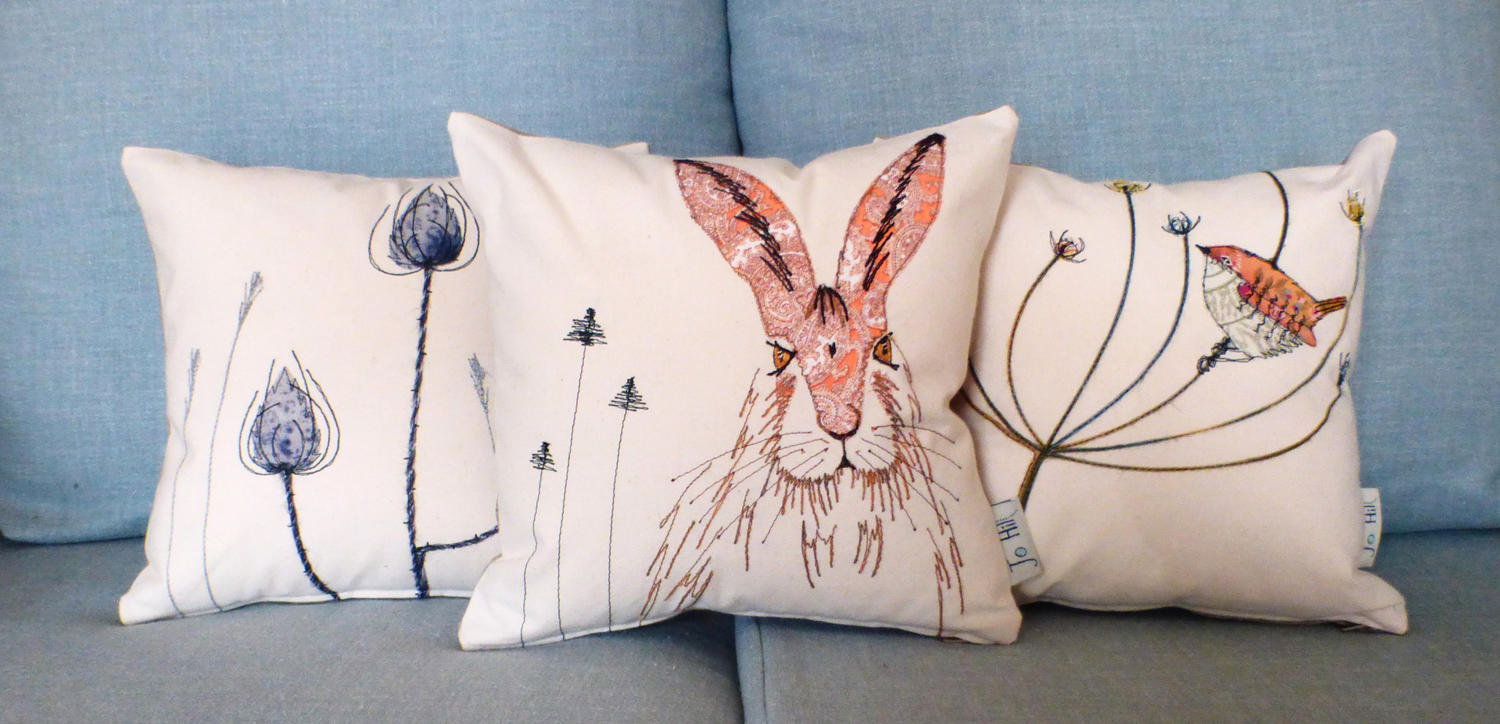 Hare and wren cushions by Jo Hill as featured in Period Living Magazine