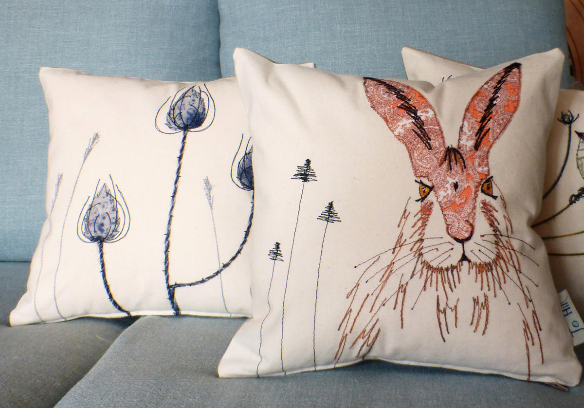 Hare and wren cushions by Jo Hill