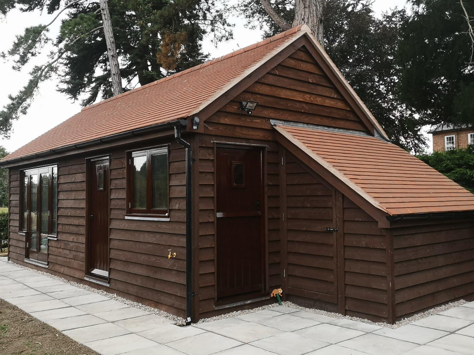 Mr D.Bishop - Herefordshire -- Image 3 -- The final result. One garden lodge with wood store complete. all supported with our Ground Screws