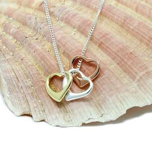 gold, rose gold and silver heart pendant