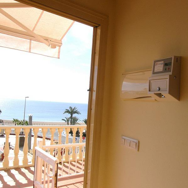 Control of air conditioning in holiday accommodation