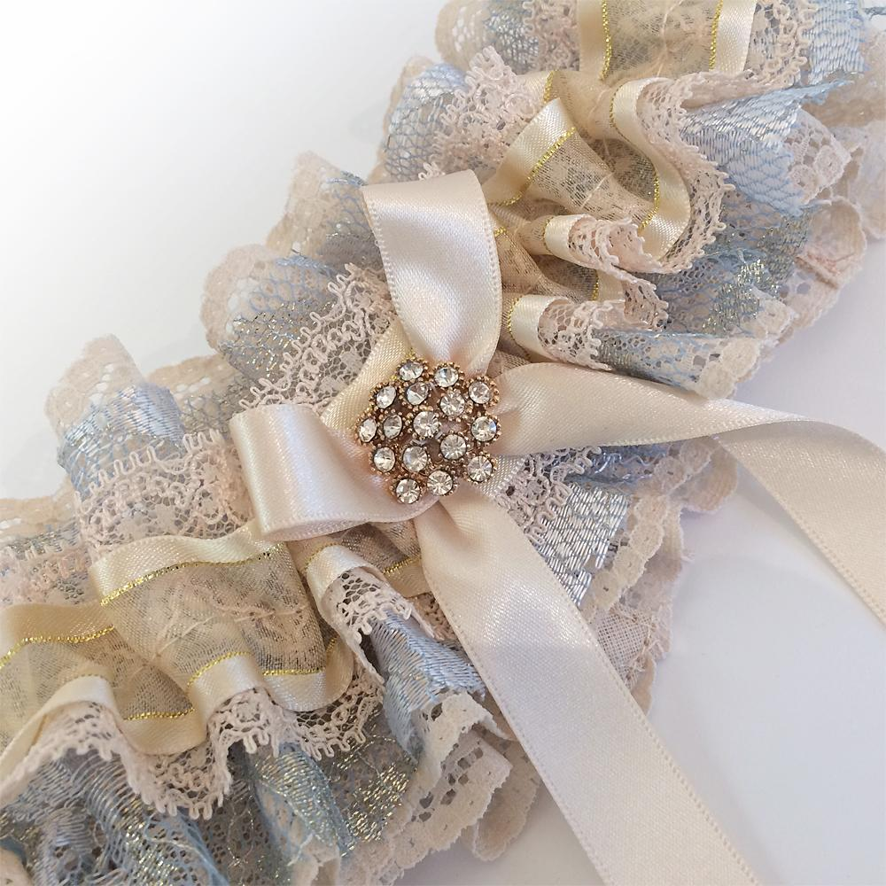 Decadent  lace ruffle wedding garter with gold crystal