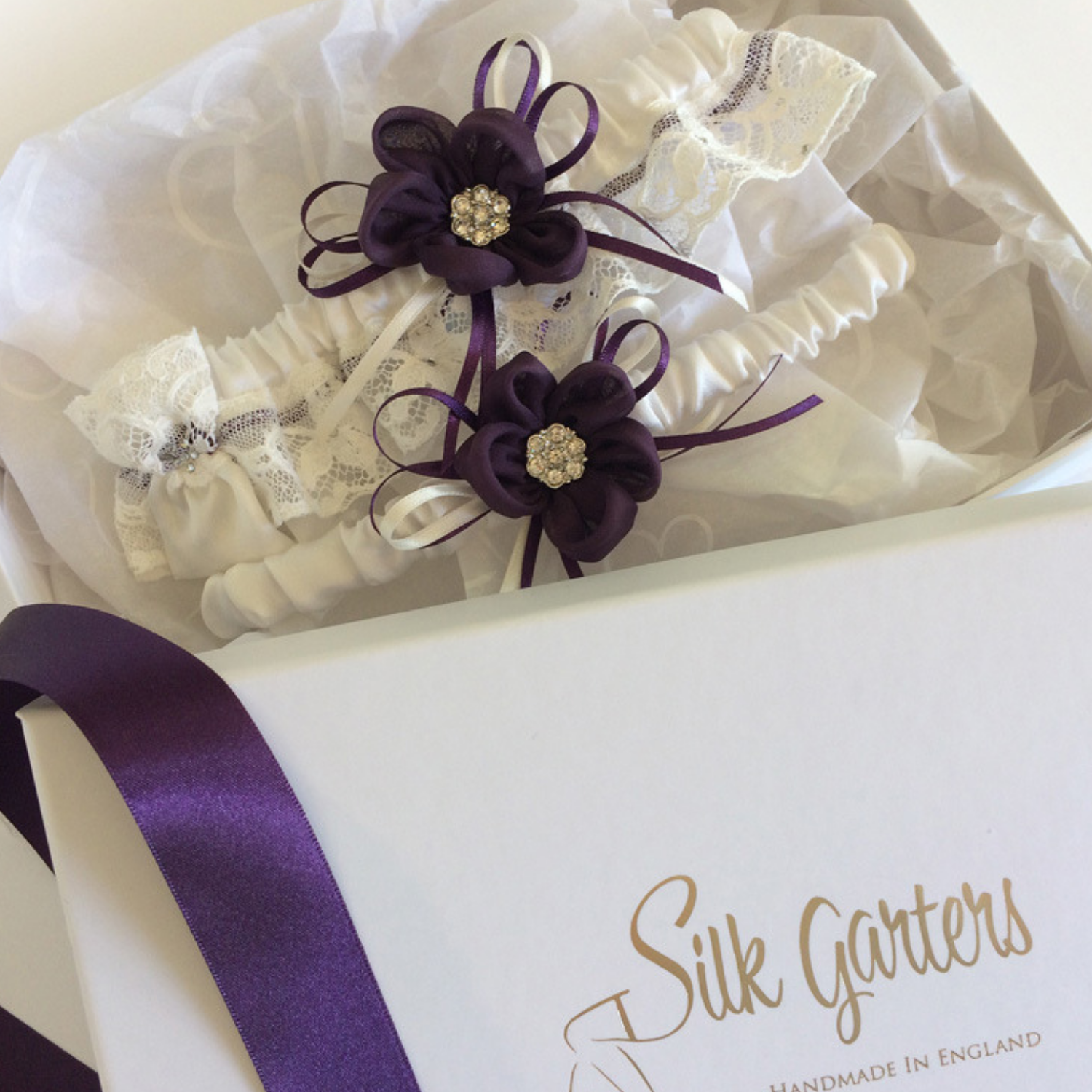 Dark purple wedding garter set