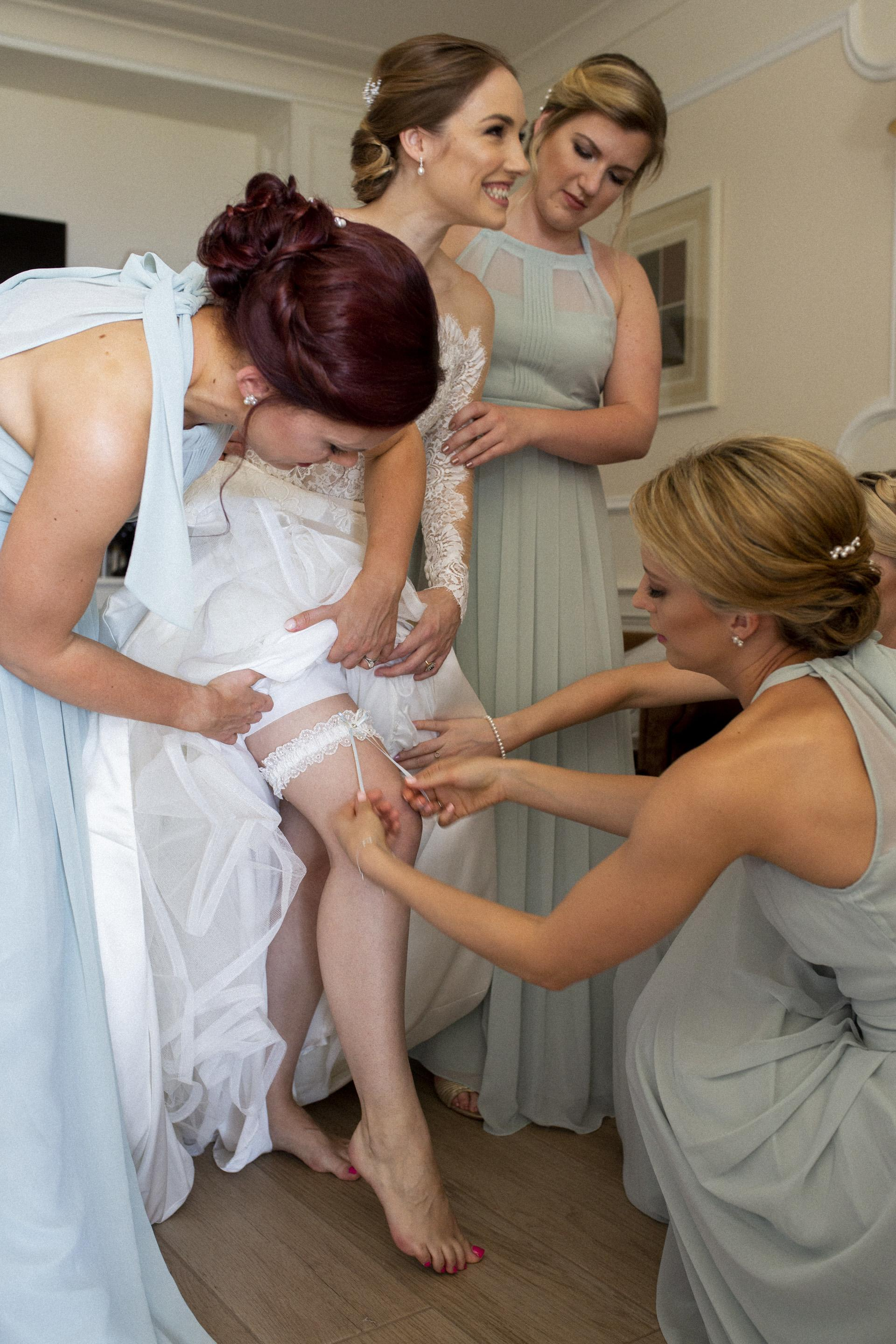Real Bride Freya wearing the Meg wedding garter in silk and lace