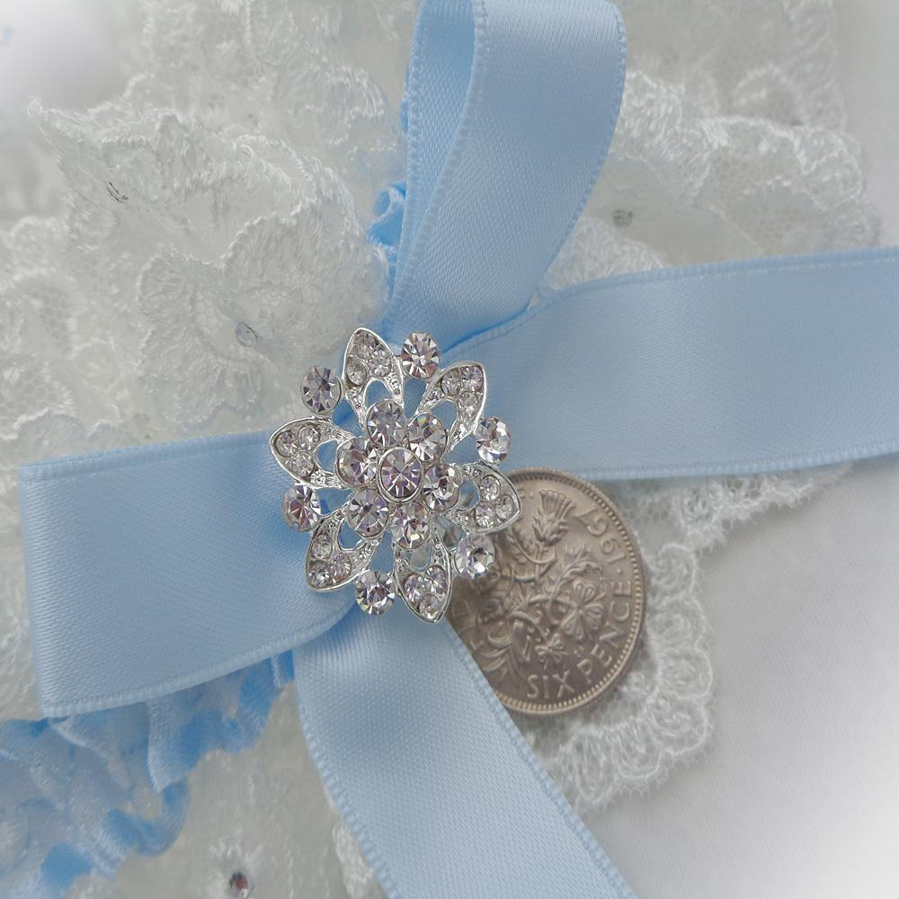 a silver sixpence in her shoe bridal garter