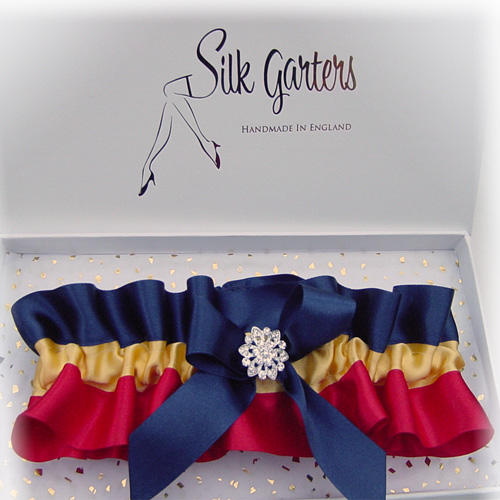 This is an image of a colourful wedding garter by silk garters
