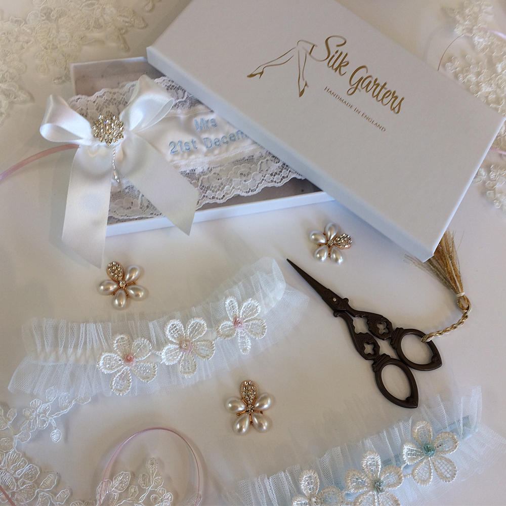 This is an image of a pretty wedding garter uk by silk garters