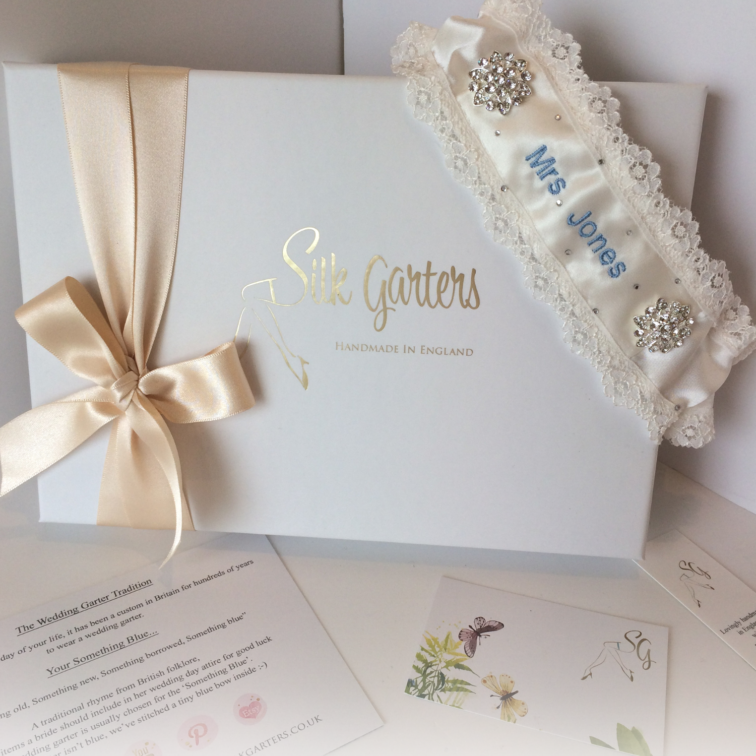 Unique personalised wedding garter with roses lace and a little bling for the bride who loves sparkle!