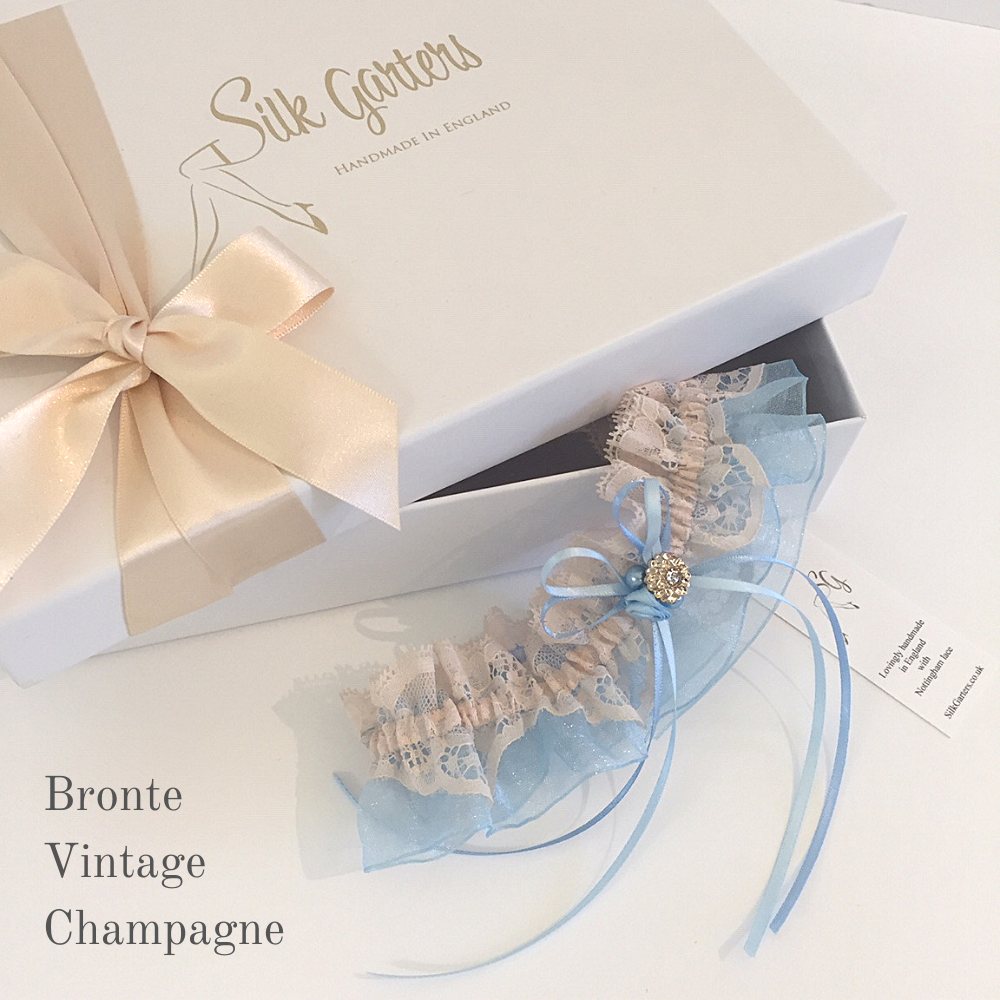 brides garter in champagne and blue