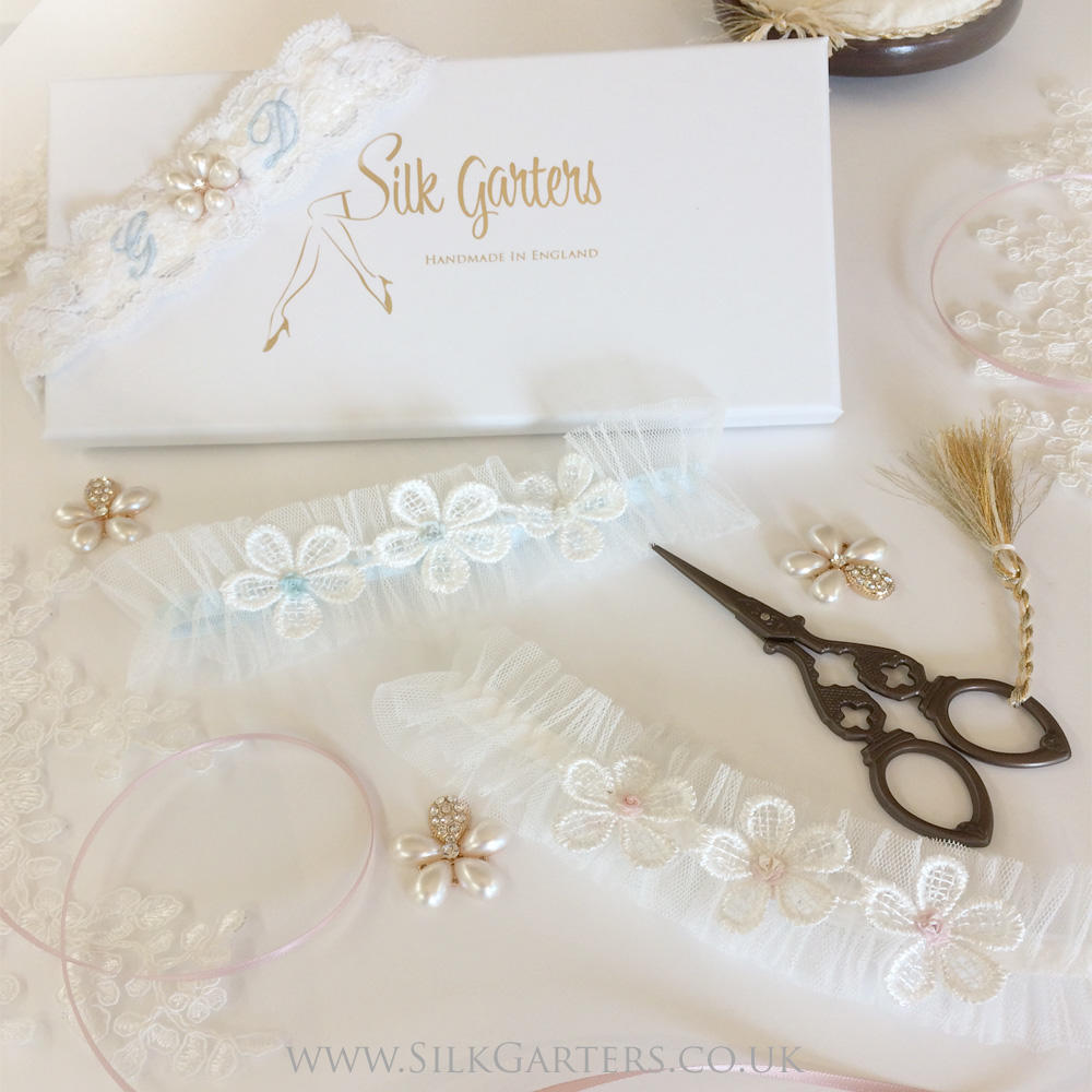 This is an image of the front of a flower wedding garter