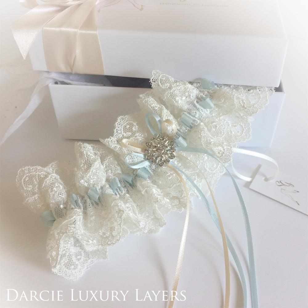 Designer wedding garter in ivory and blue