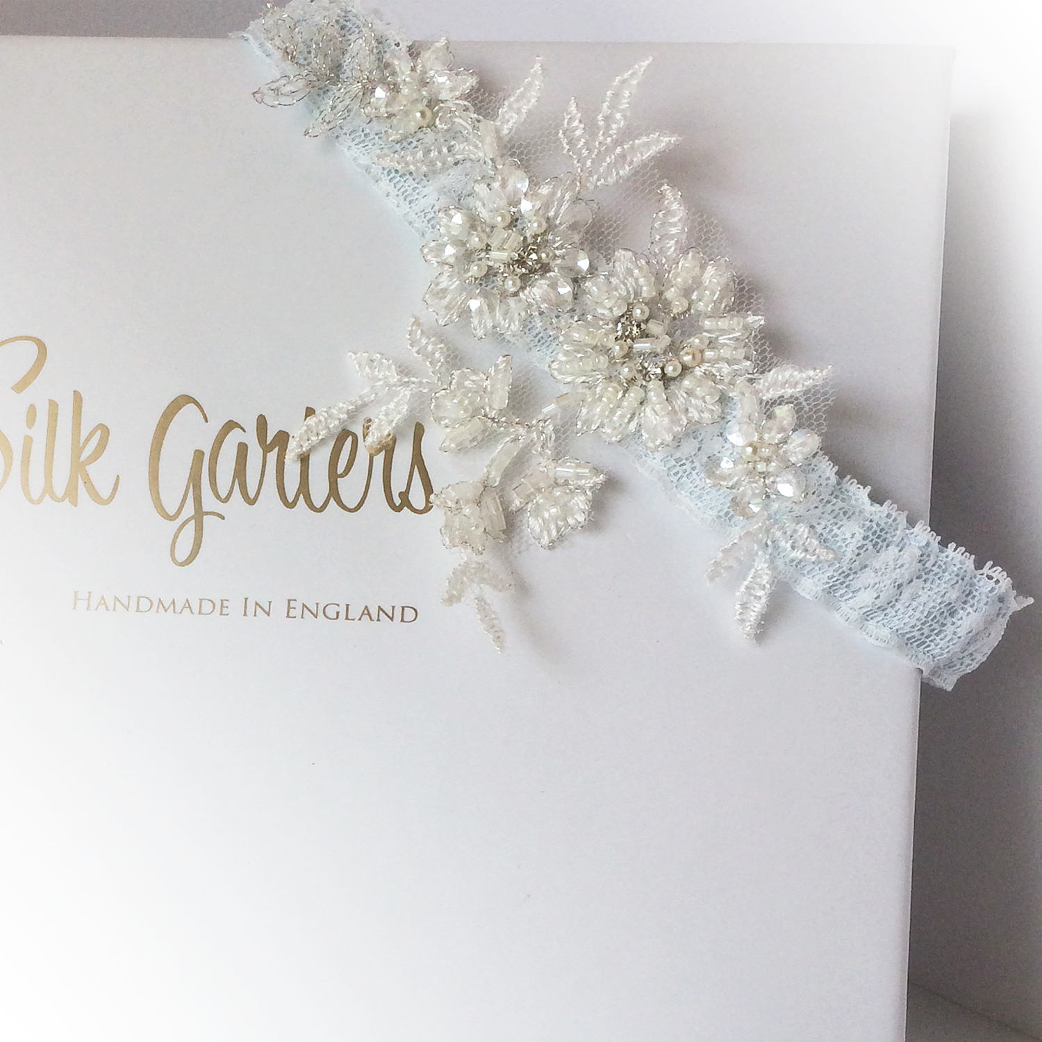 Lace wedding garter Mia blue